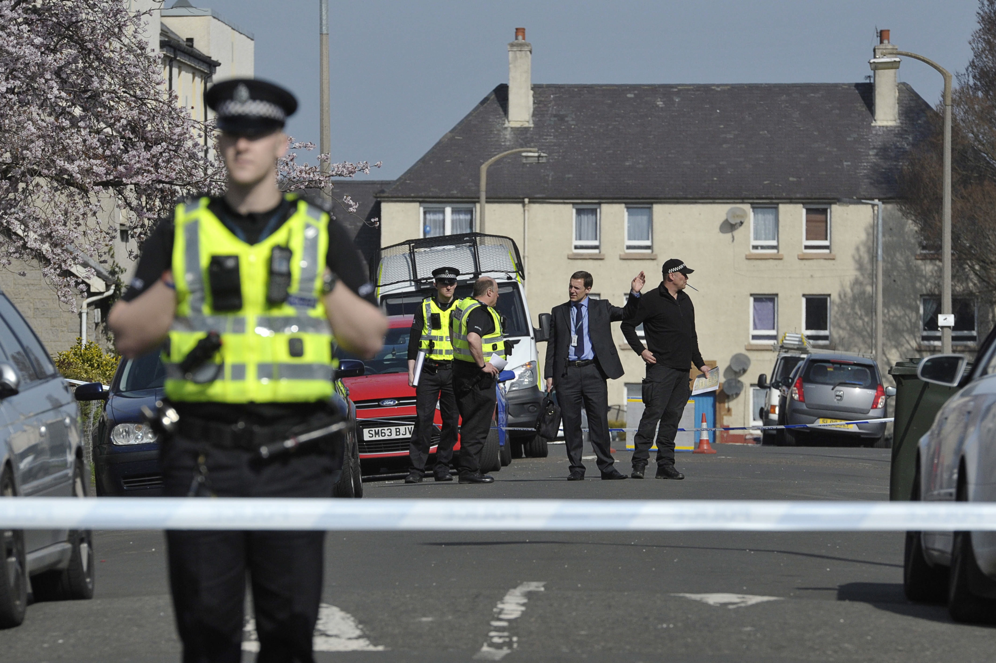Police at the scene where the two men from Aberdeen were stabbed in Edinburgh.