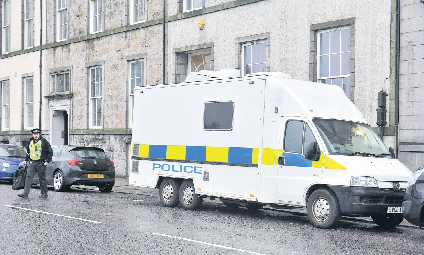 A police presence remained outside the flat on Union Terrace over the weekend.