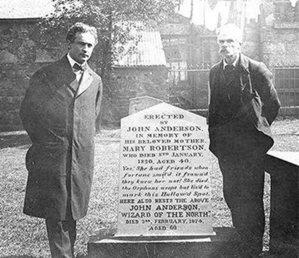 Houdini,left, at John Anderson's Graveside in the St. Nicholas Kirk yard.