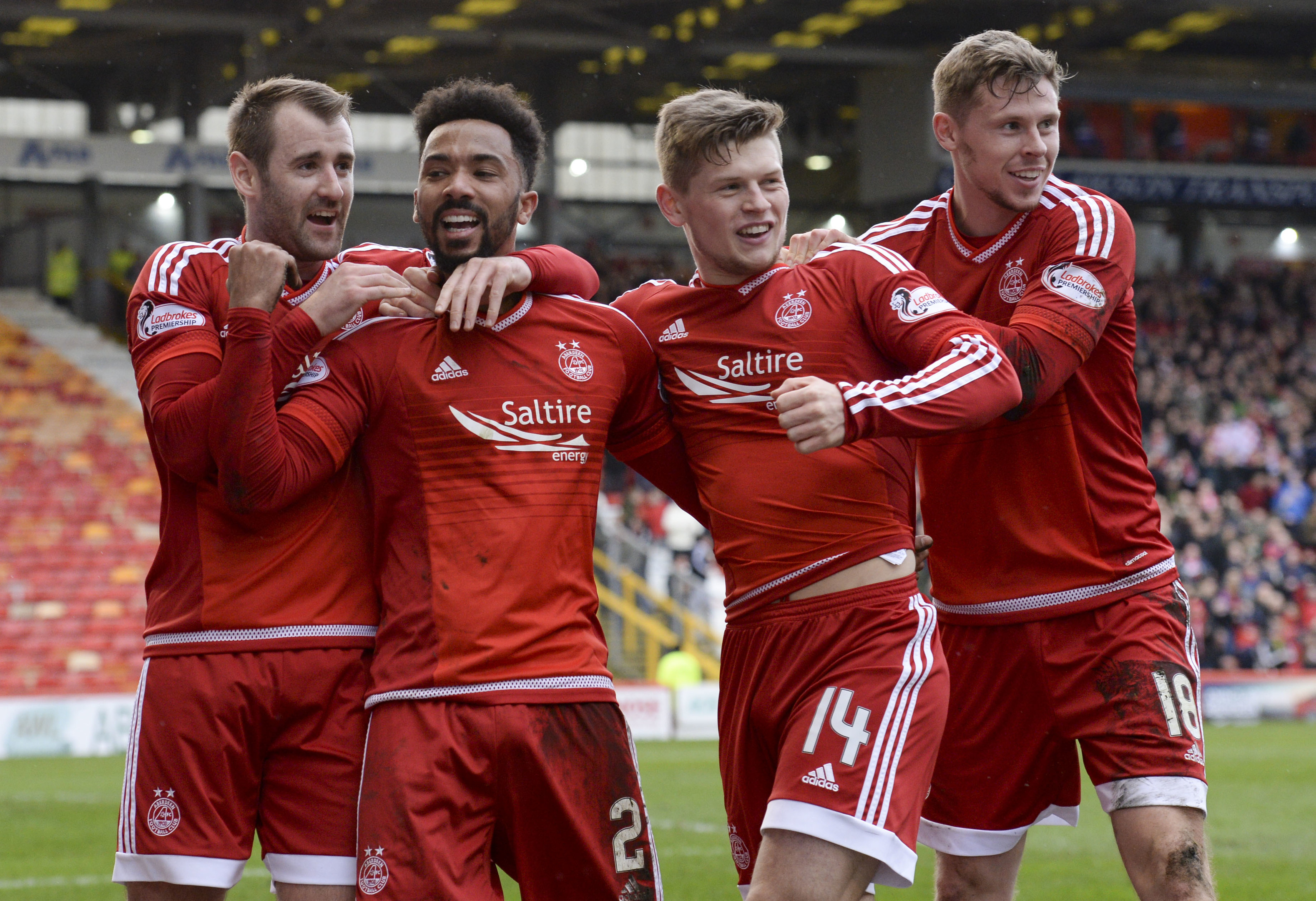 Shay Logan (2nd from left) is congratulated by team mates Niall McGinn, Cammy Smith and Simon Church after scoring Aberdeen's second goal