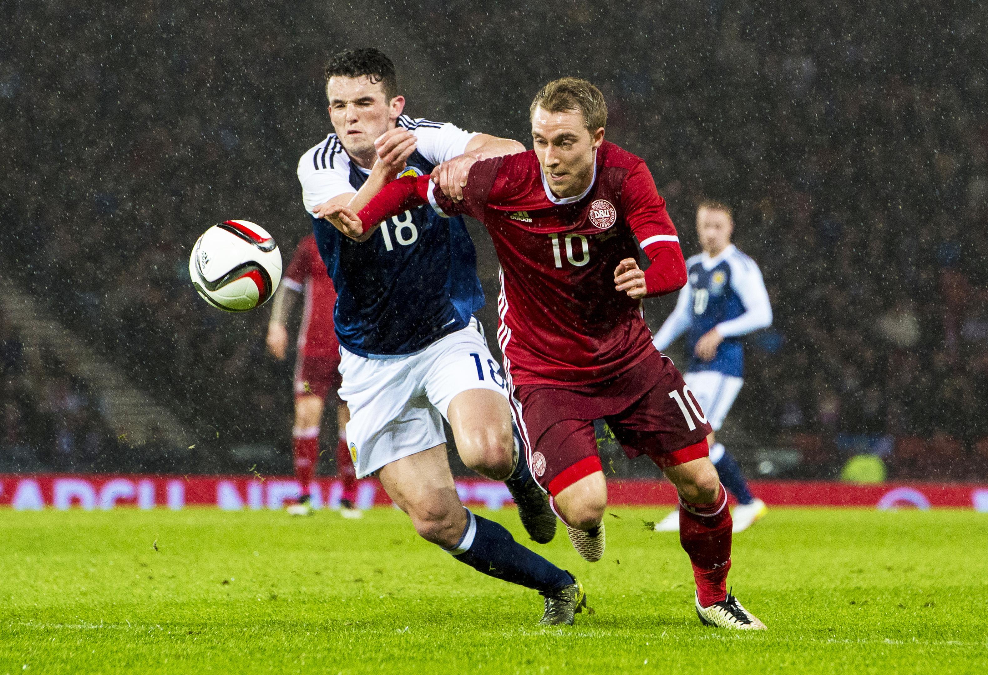 Denmark star Christian Eriksen and Scotland's John McGinn in action during a 2016 friendly, which Scotland won 1-0.