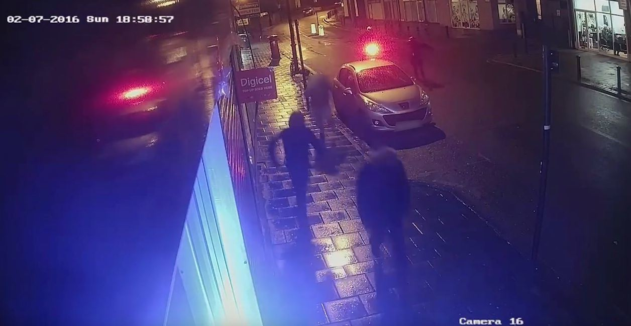 CCTV captured in Brixton shows a man with a gun chasing three men.