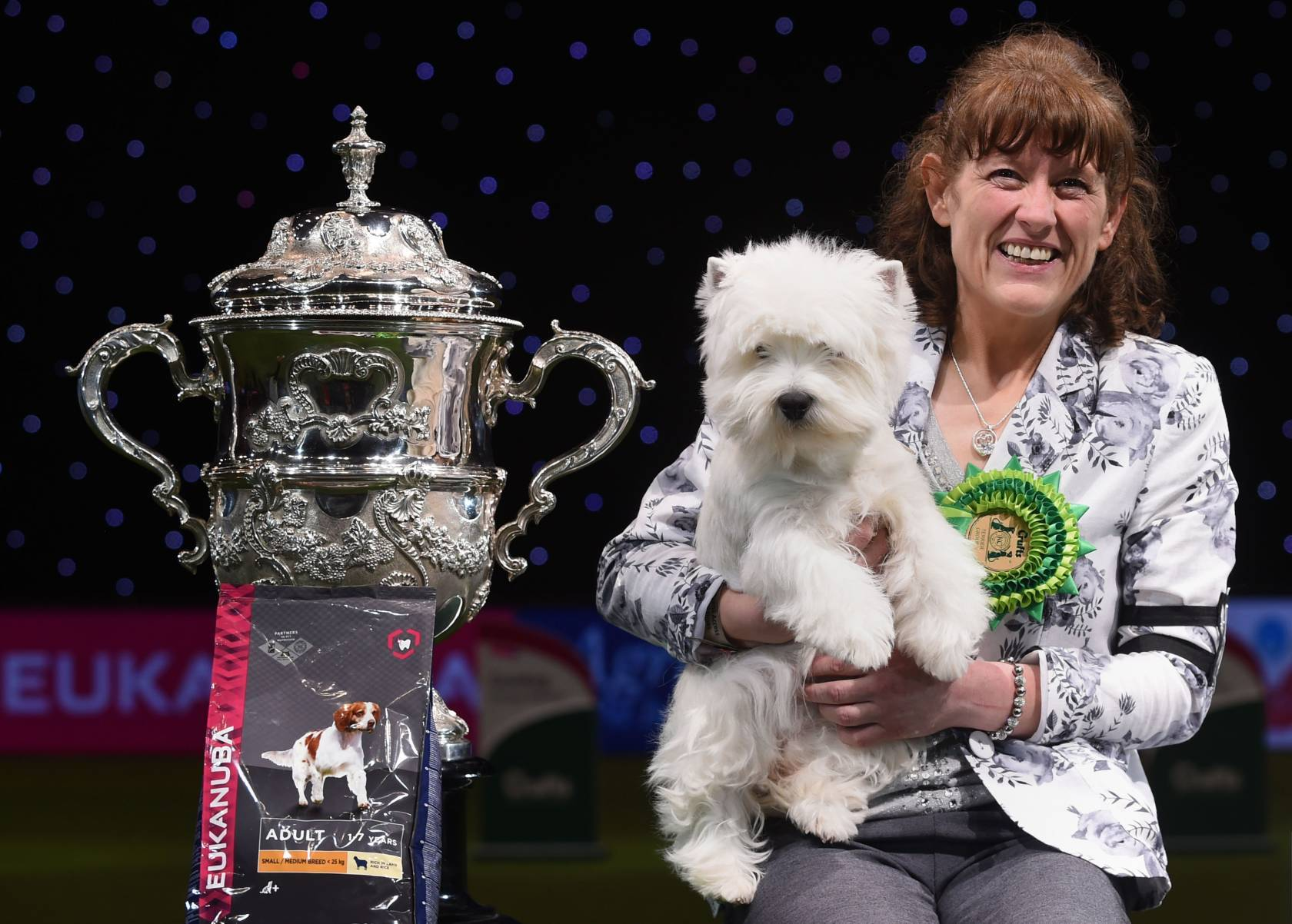 Devon the West Highland Terrier (with handler) who has been named  Best in Show at Crufts 2016 at the NEC, Birmingham.