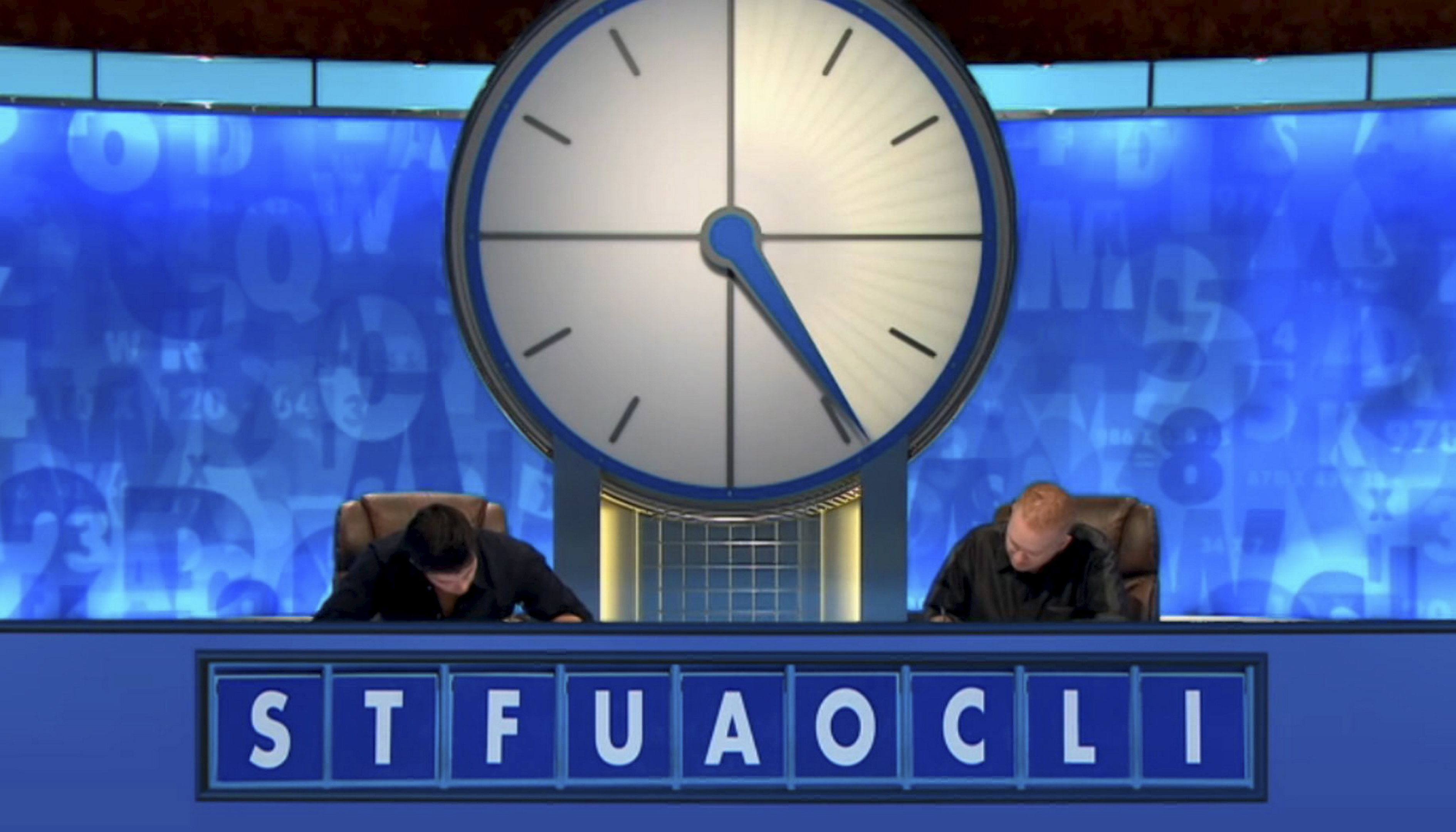 Paul Craib, right,  puzzling out a solution on Countdown.  picture courtesy of channel 4
