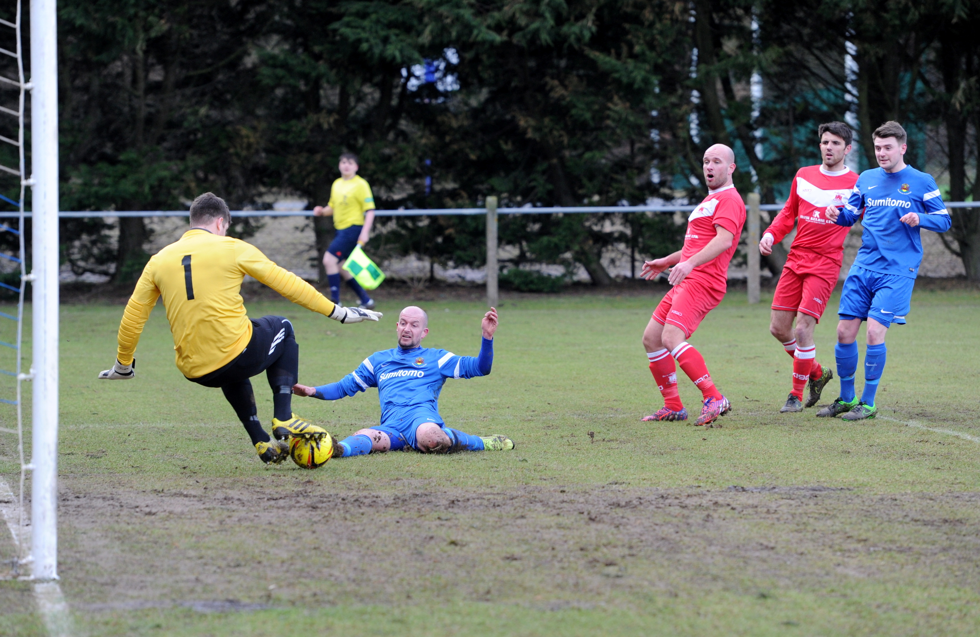 Broughty's goalie Iain Ross blocks Stonehaven's Martin Shand. Pictures by Kath Flannery.