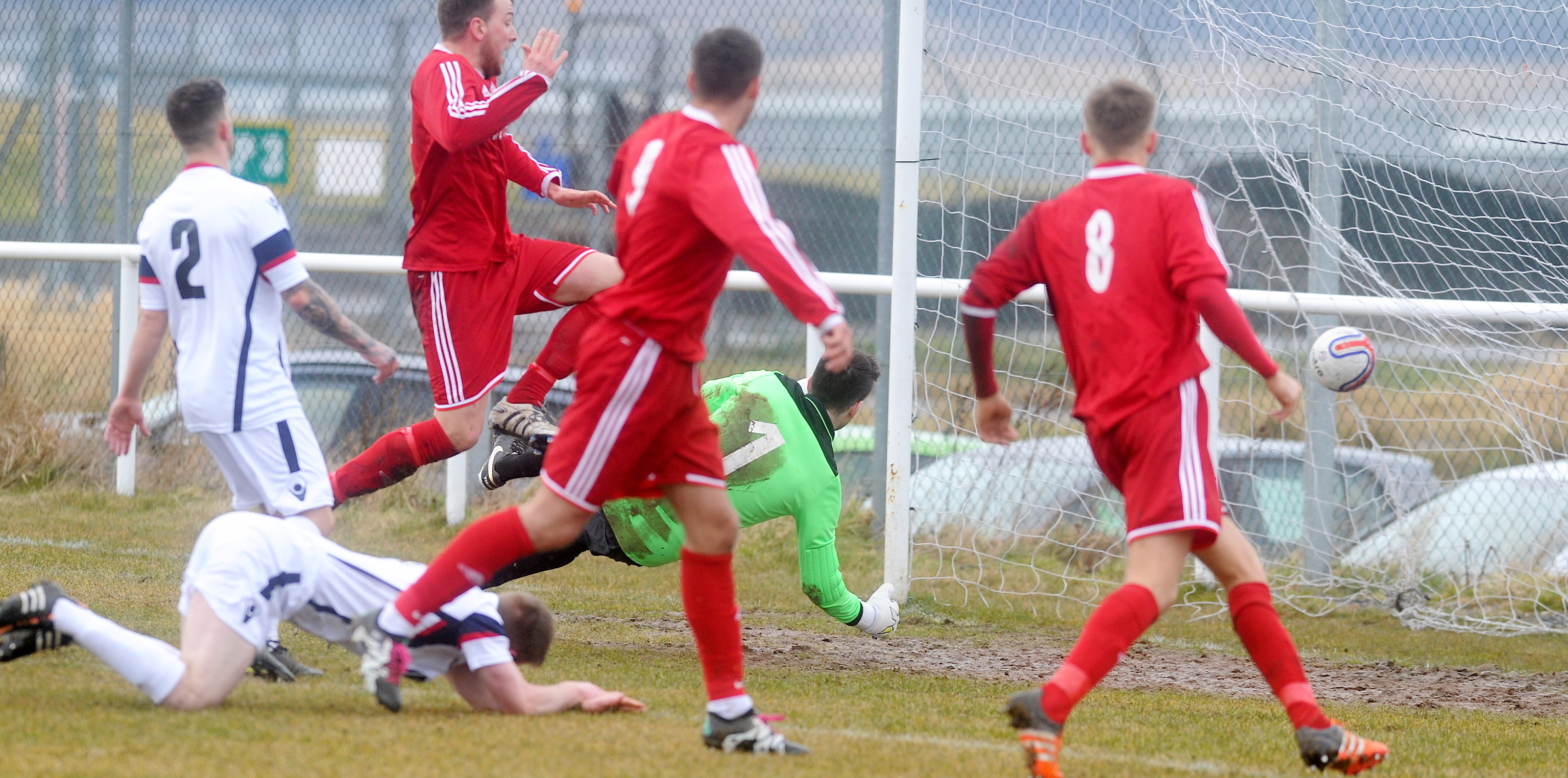 Stoneywood's Liam Bain, left, scores the opener.