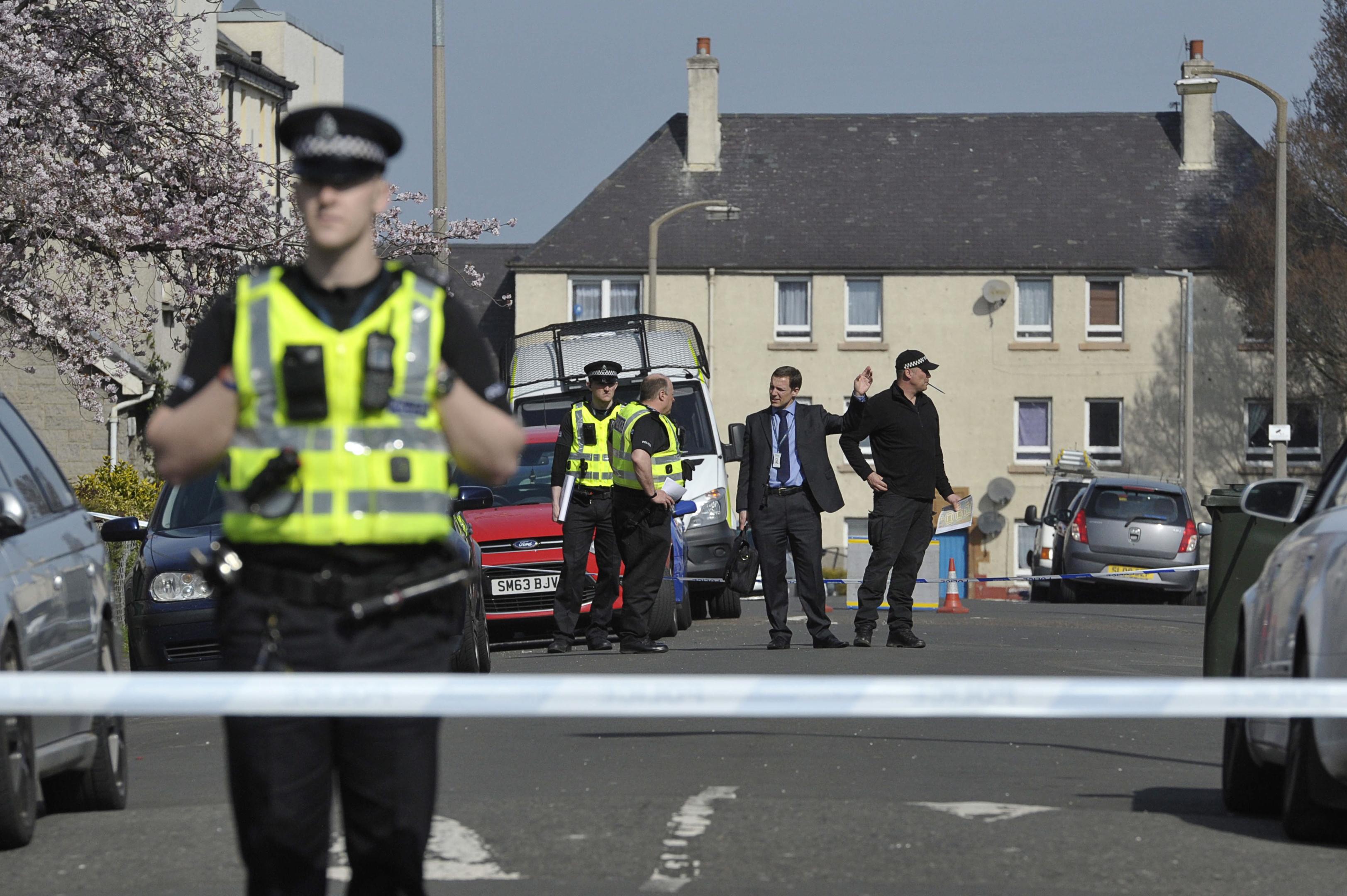 Police at the scene of the incident in Edinburgh's Wardieburn area.