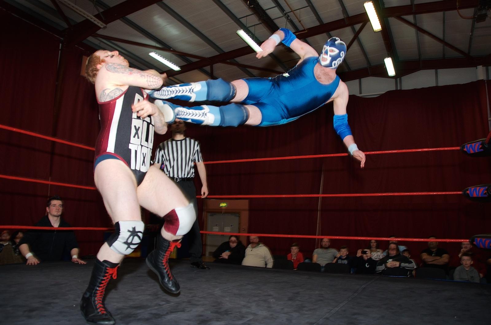 Blue Thunder nails a drop kick on Damien.
