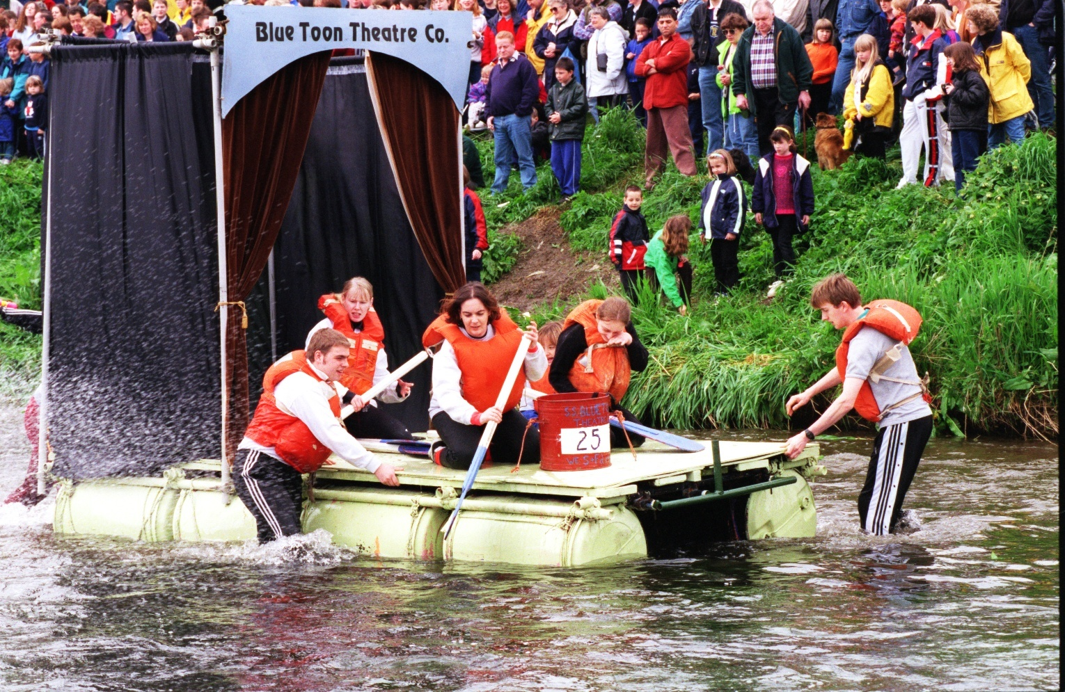 One of the entries in the 1998  Ythan Raft Race, Blue Toon Theatre Co, takes to the water at Ellon.