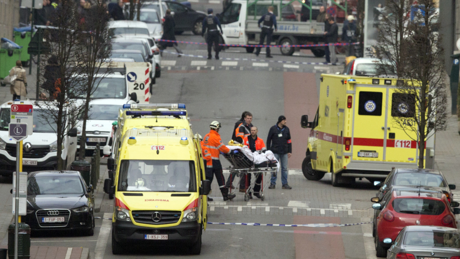 A victim is evacuated on a stretcher by emergency services after a explosion in a main metro station in Brussels (AP)