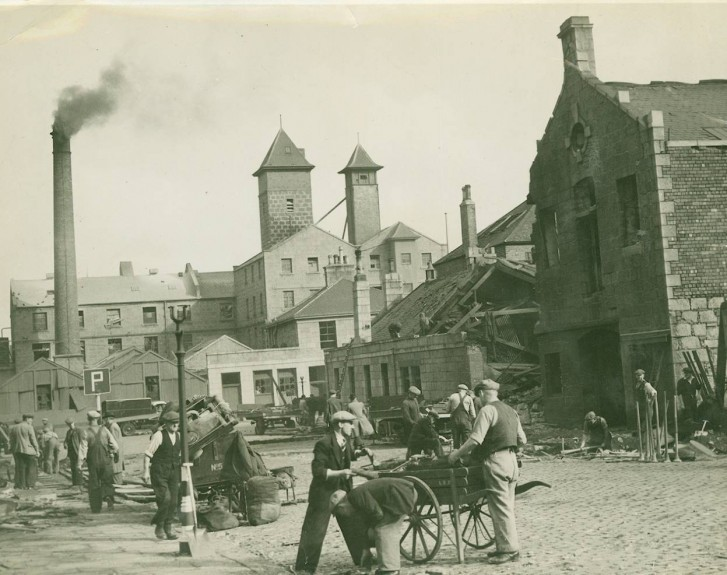 Workmen clear up bomb damage in Aberdeen's Stell Road after a World War 2 German air raid in August 1941.