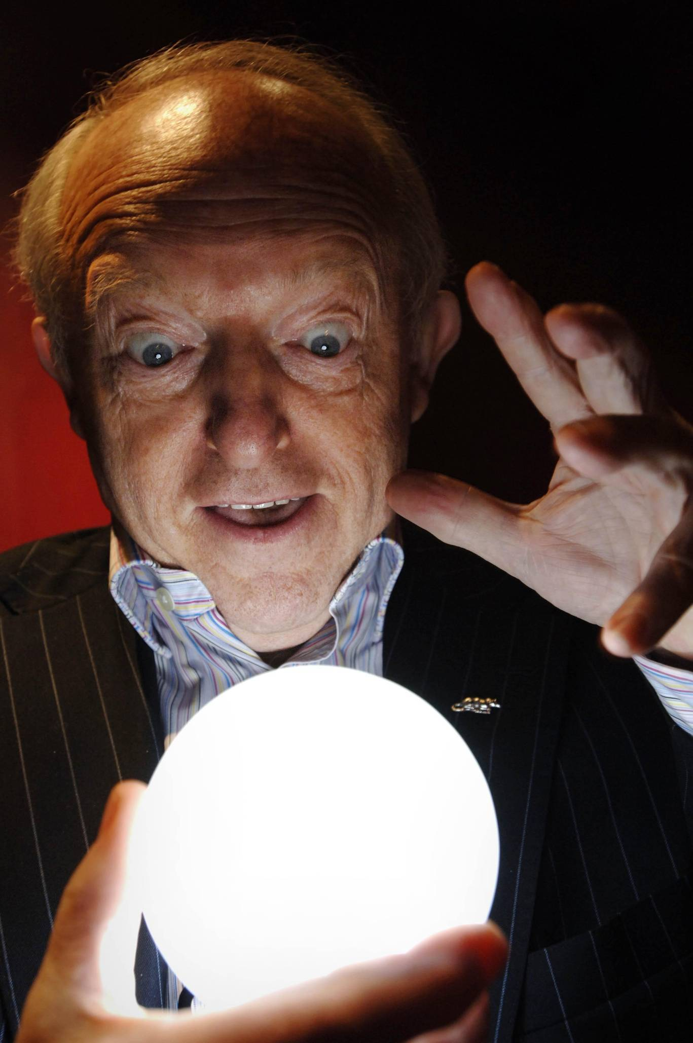 Paul Daniels gazing into a crystal ball at the Special Magician's Screening of The Illusionist.