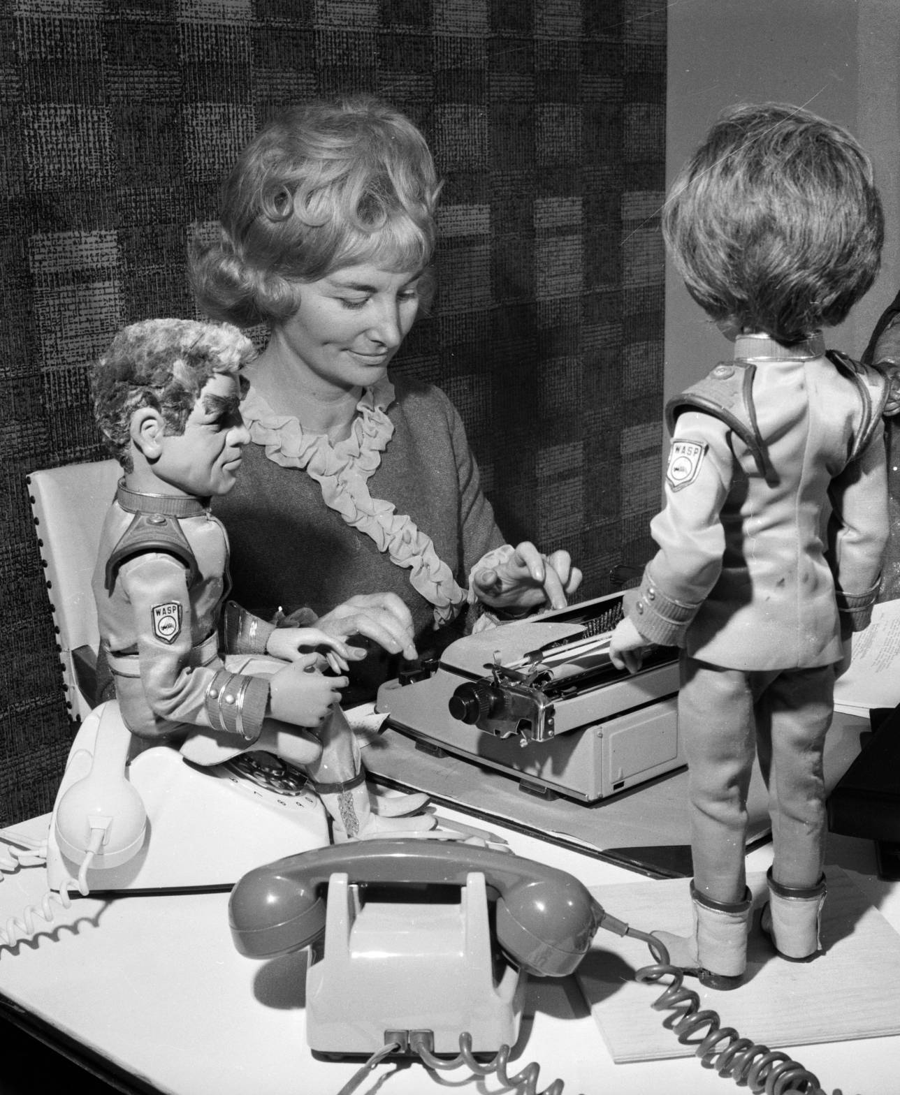 Sylvia Anderson, co-director of AP Studios and designer of the puppets used in the TV adventure series 'Stingray', with two characters from the series 'Commander Shore and Atlanta'.