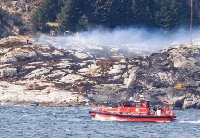 A search and rescue vessel patrols off the coast of the island of Turoey after the crash