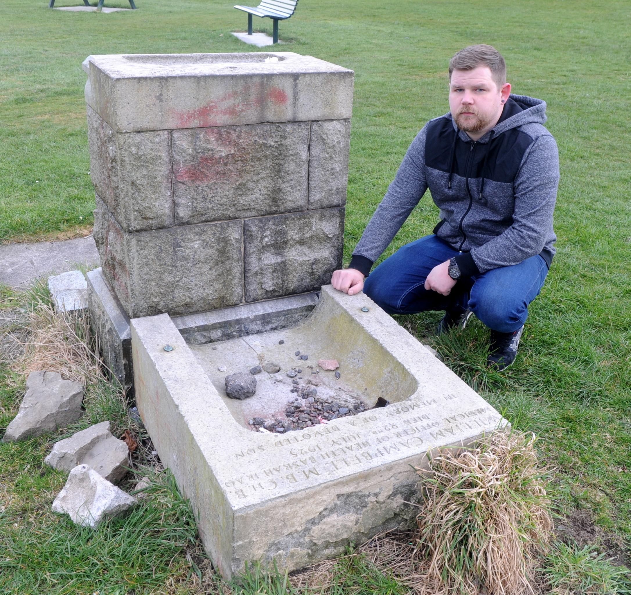 Craig Jeffrey  next to  the   memorial in the Bucksburn park.