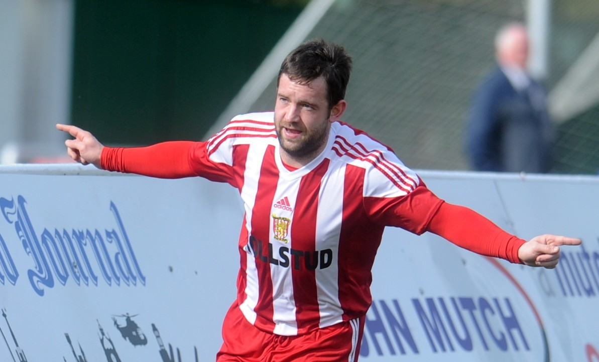 Formartine's Neil Gauld celebrates his first goal against Huntly.