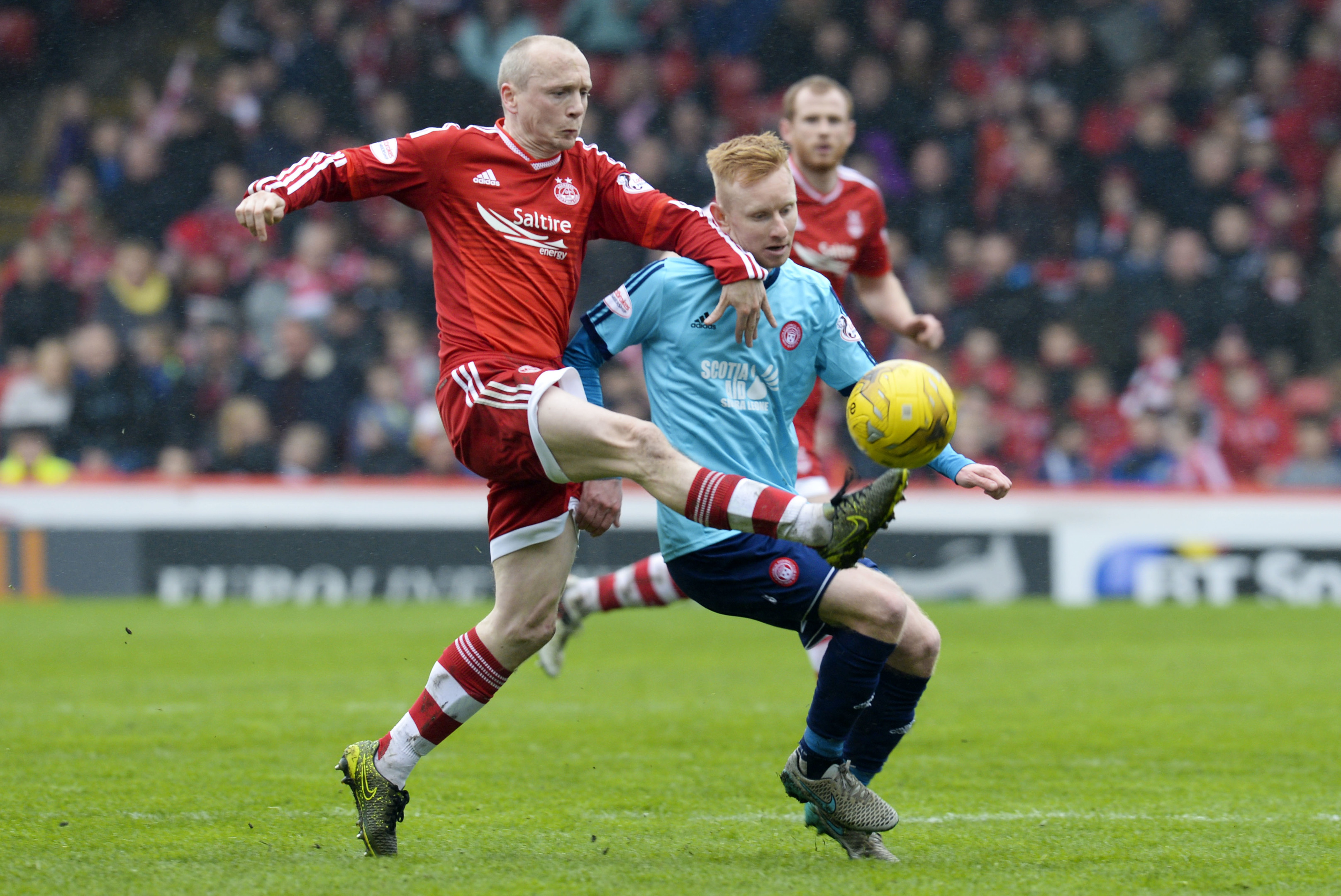 Hamilton's Ali Crawford, right, challenges Dons midfielder Willo Flood at Pittodrie.