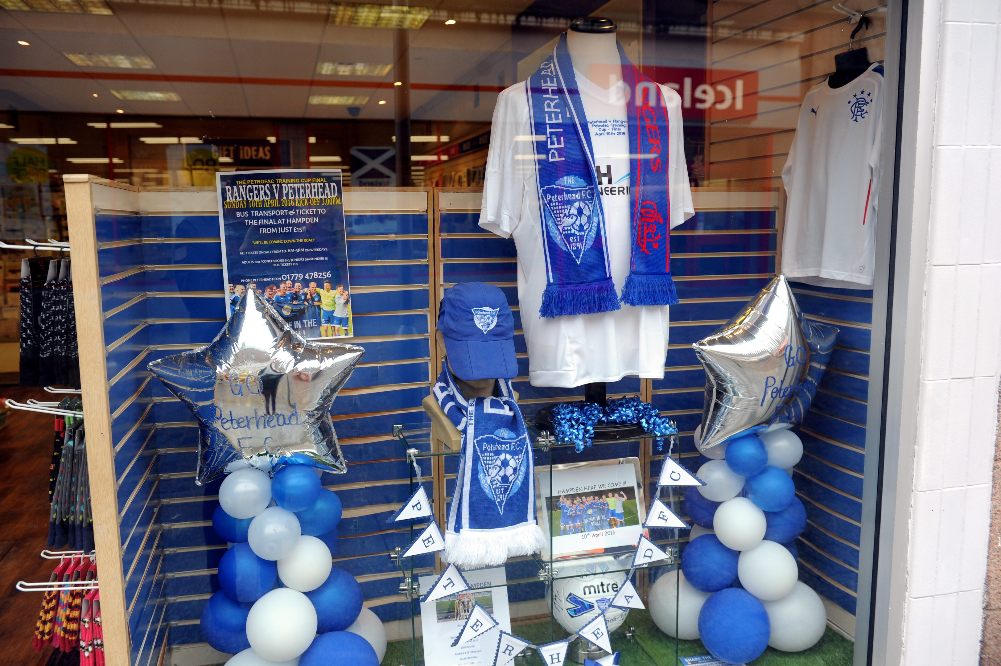 Some of the shops in Peterhead showing their colours before the final.