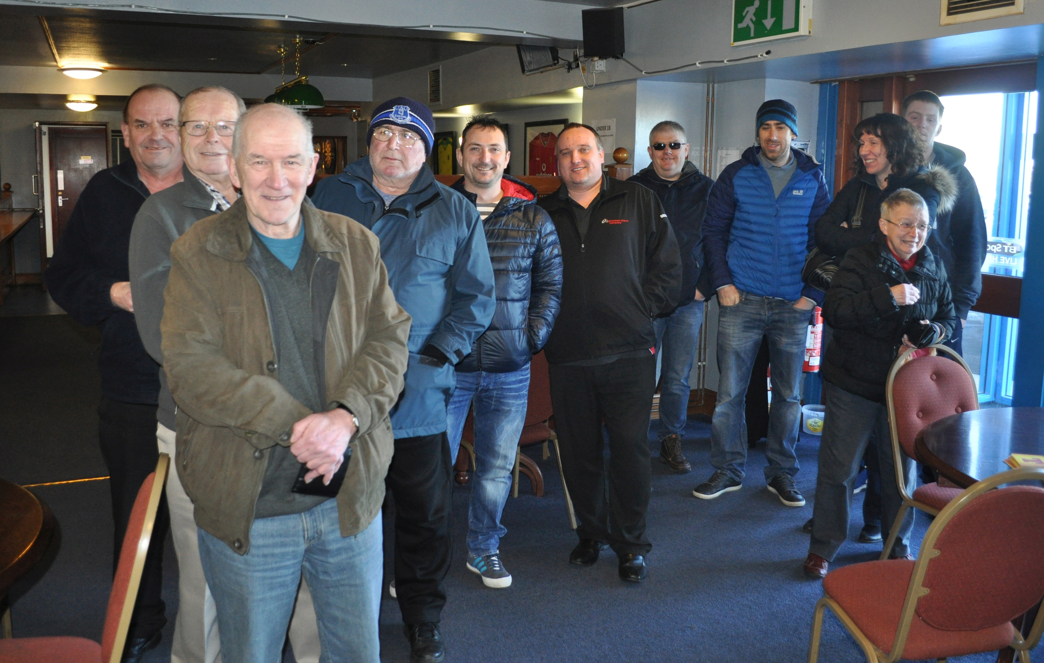 Fans queue at Balmoor as tickets for Peterhead FC's Petrofac Cup Final v Rangers go on sale. Fourth from left is John Reeves, Ed's father.
