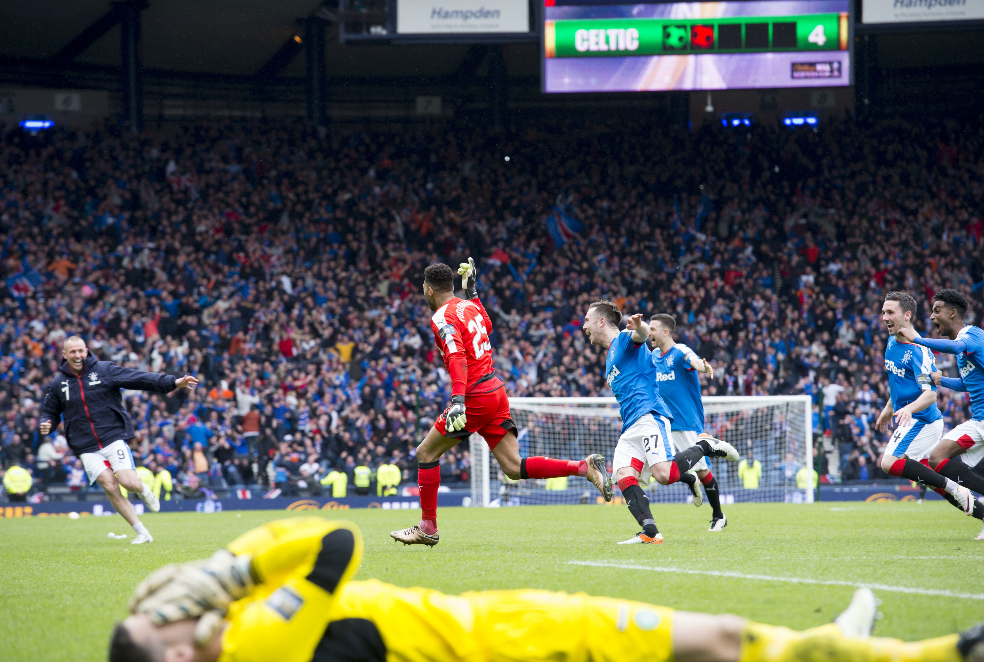Rangers players celebrate after beating Celtic at Hampden