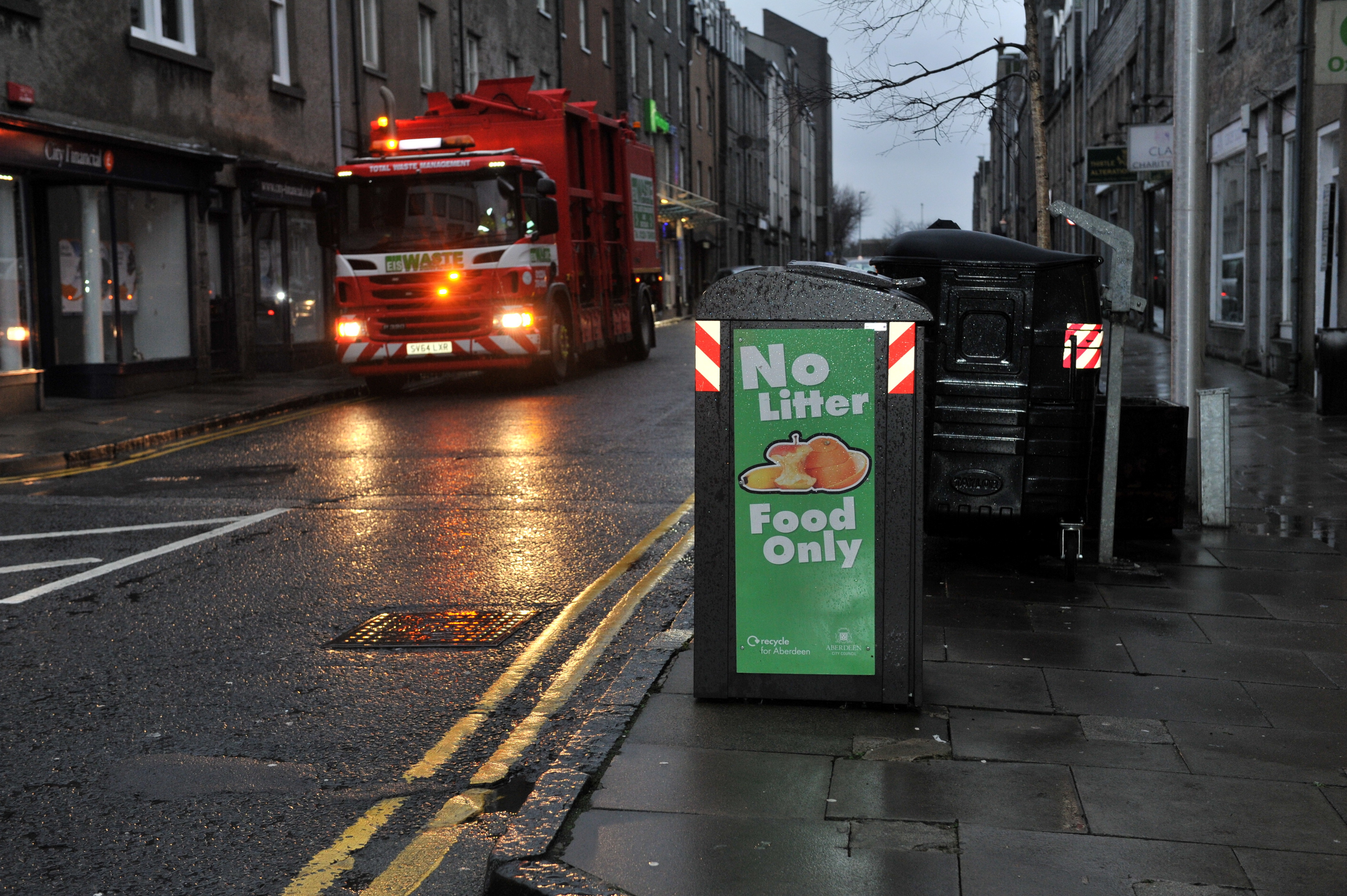 A scheme where locks were fitted to food waste bins to prevent litter contamination has been a success.