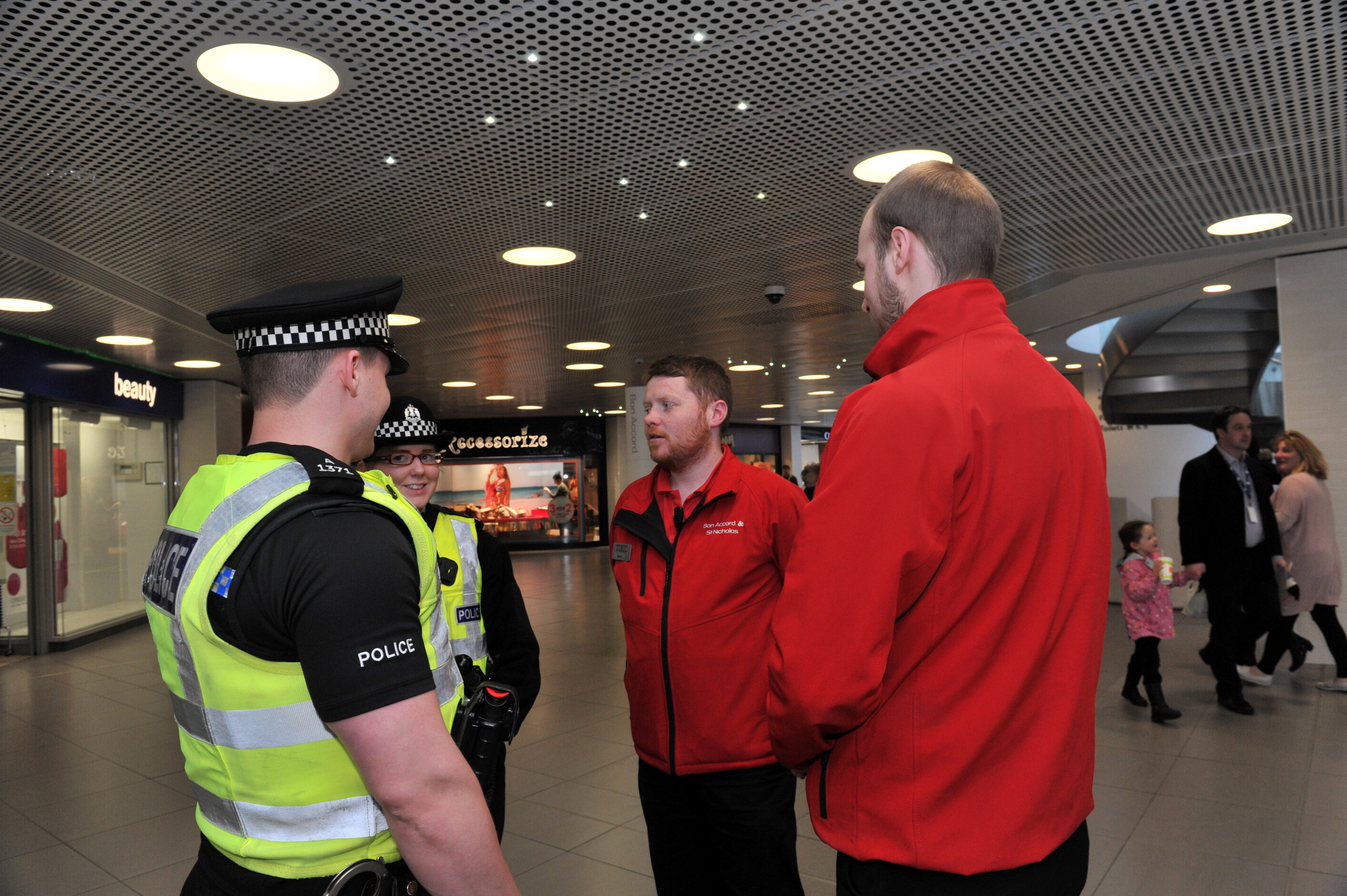 From left, Pc Mark McKenzie and Pc Jessica McGuckin with Bon Accord Centre security staff Steven Leask and Stephen Smith.