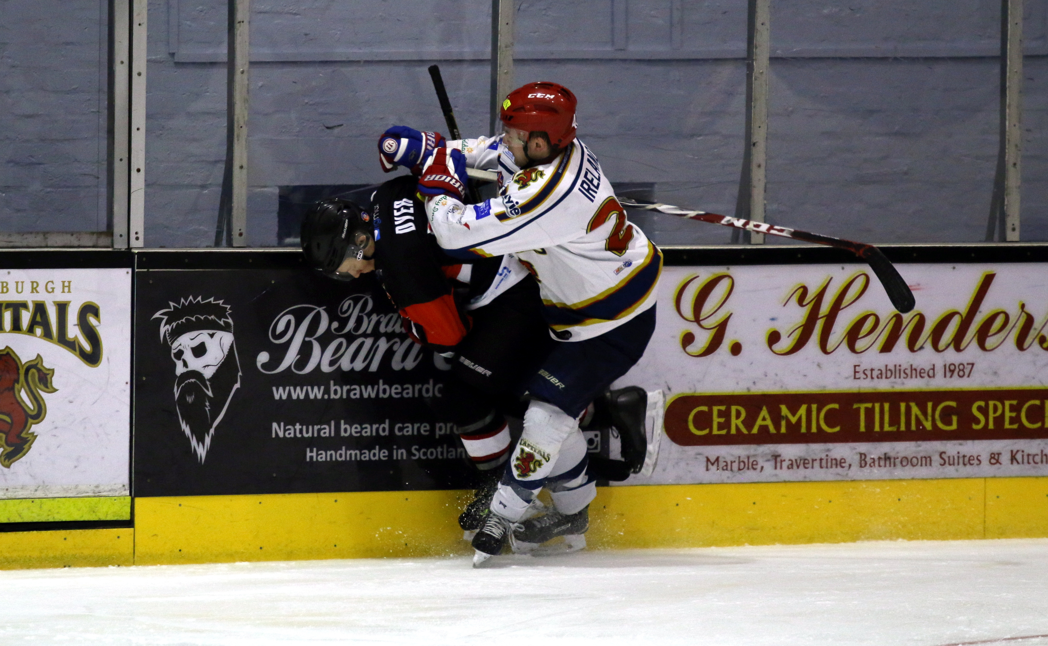 Aberdeen Lynx's Sean Dyer goes down after a strong tackle by Edinburgh Capitals' Michael Ireland. Picture by Ferguson Photography.