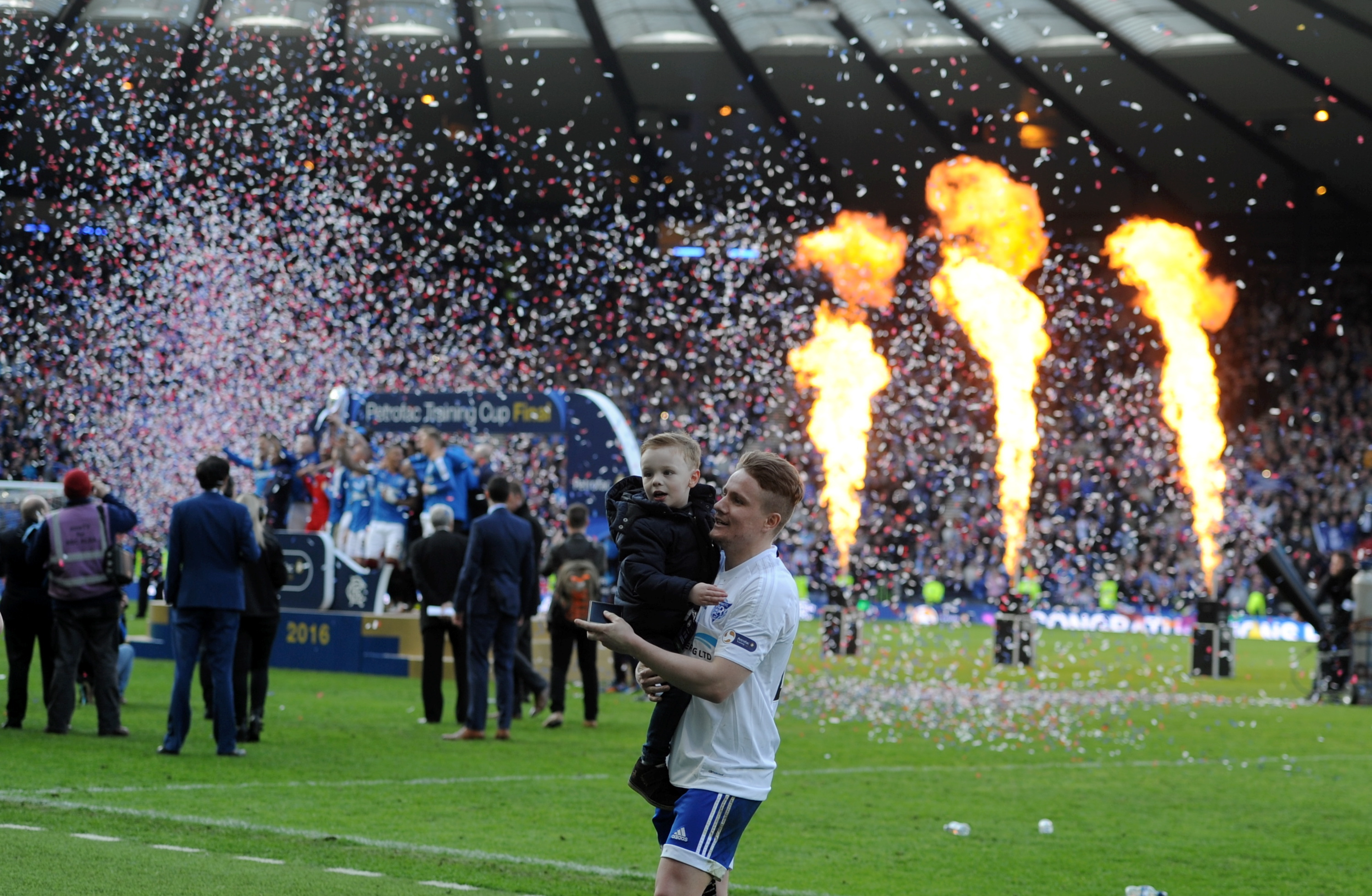 Simon Ferry as Rangers lift the trophy in the background.