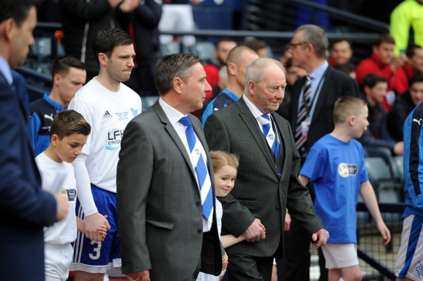 "Petrofac Training Cup Final Hampden Park, Glasgow Rangers v Peterhead FC Pictured is Peterhead's Norman ""Bomber"" Crighton leading the team out at the start of the game with manager Jim McInally. Picture by DARRELL BENNS     Pictured on 10/04/2016"