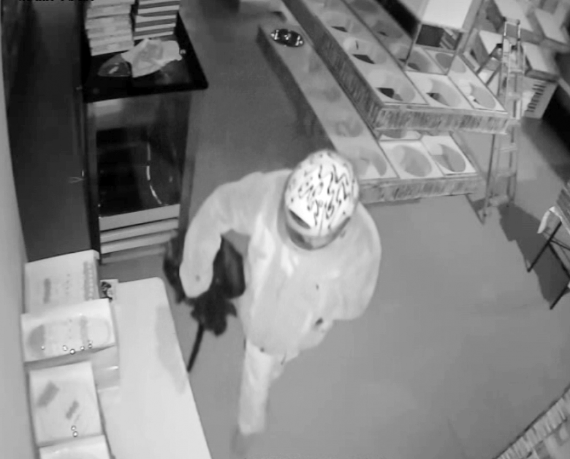CCTV issued by the Metropolitan Police showing a masked arsonist who calmly poured petrol around the Tavazo bakery in Finchley, north London, before sending a surge of flames shooting through the building.