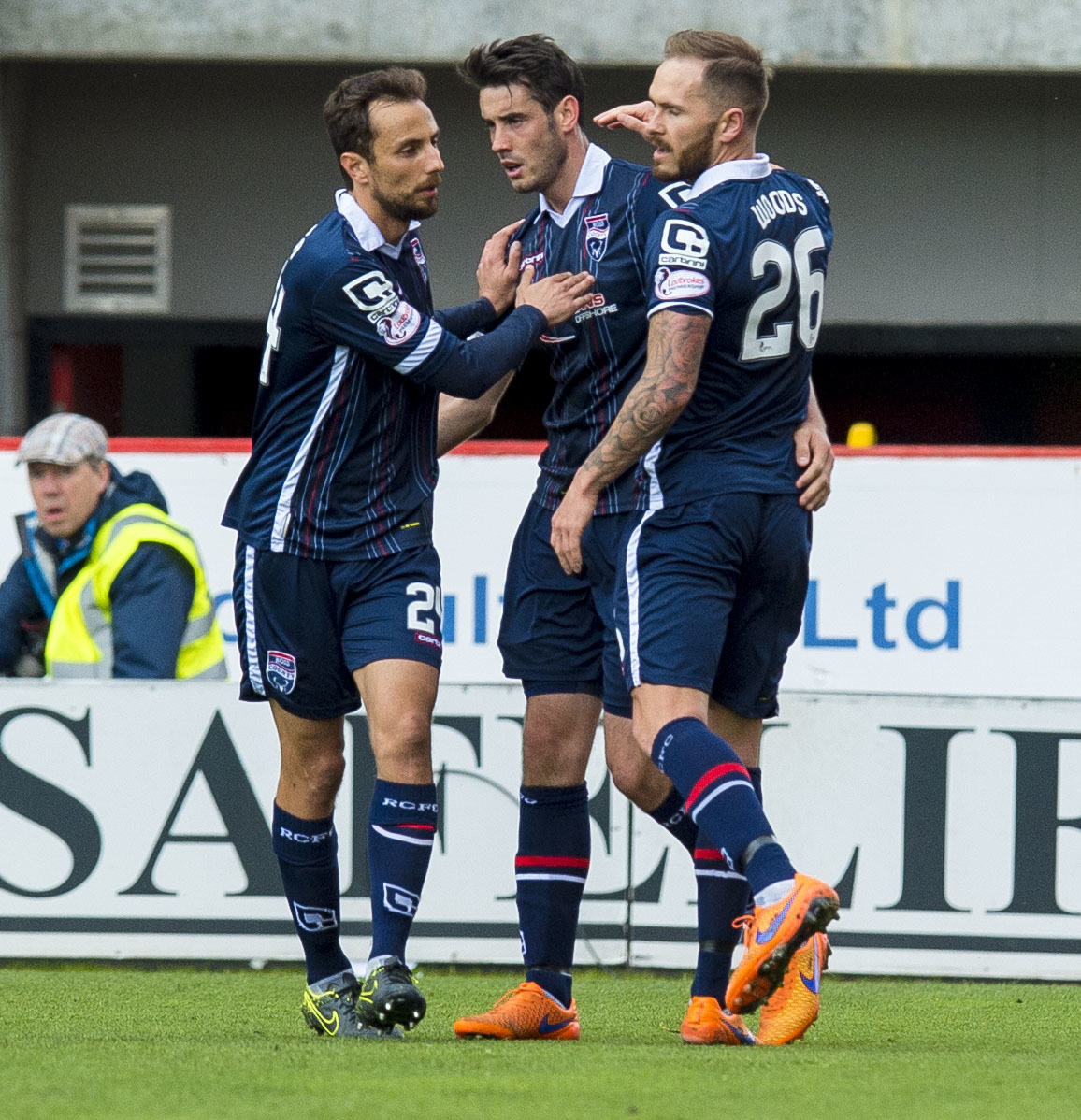 Ross County's Brian Graham (centre) celebrates scoring a penalty with his team mates