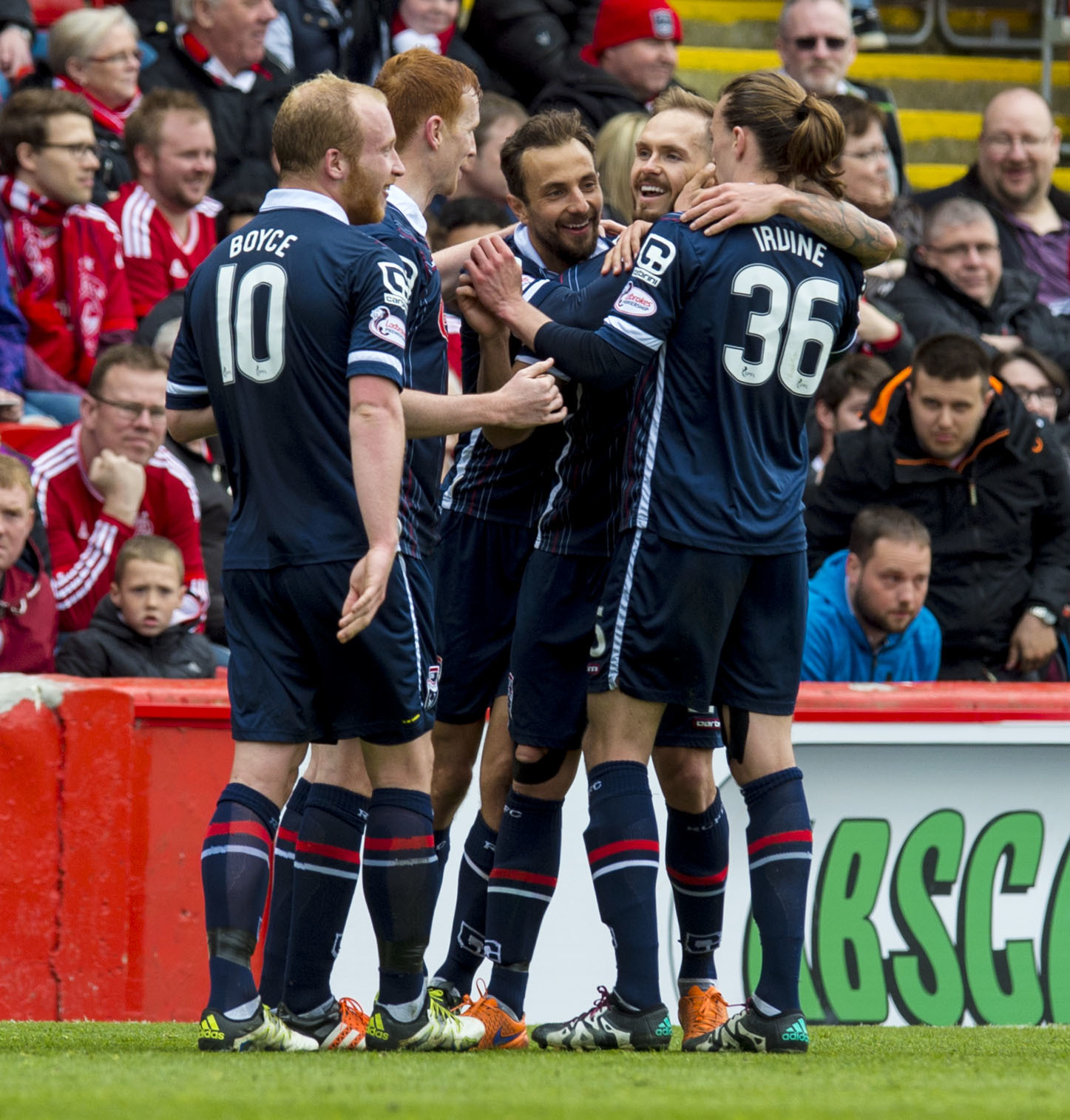 Ross County's Martin Woods (2nd right) celebrates with his team mates after making it 4 - 0