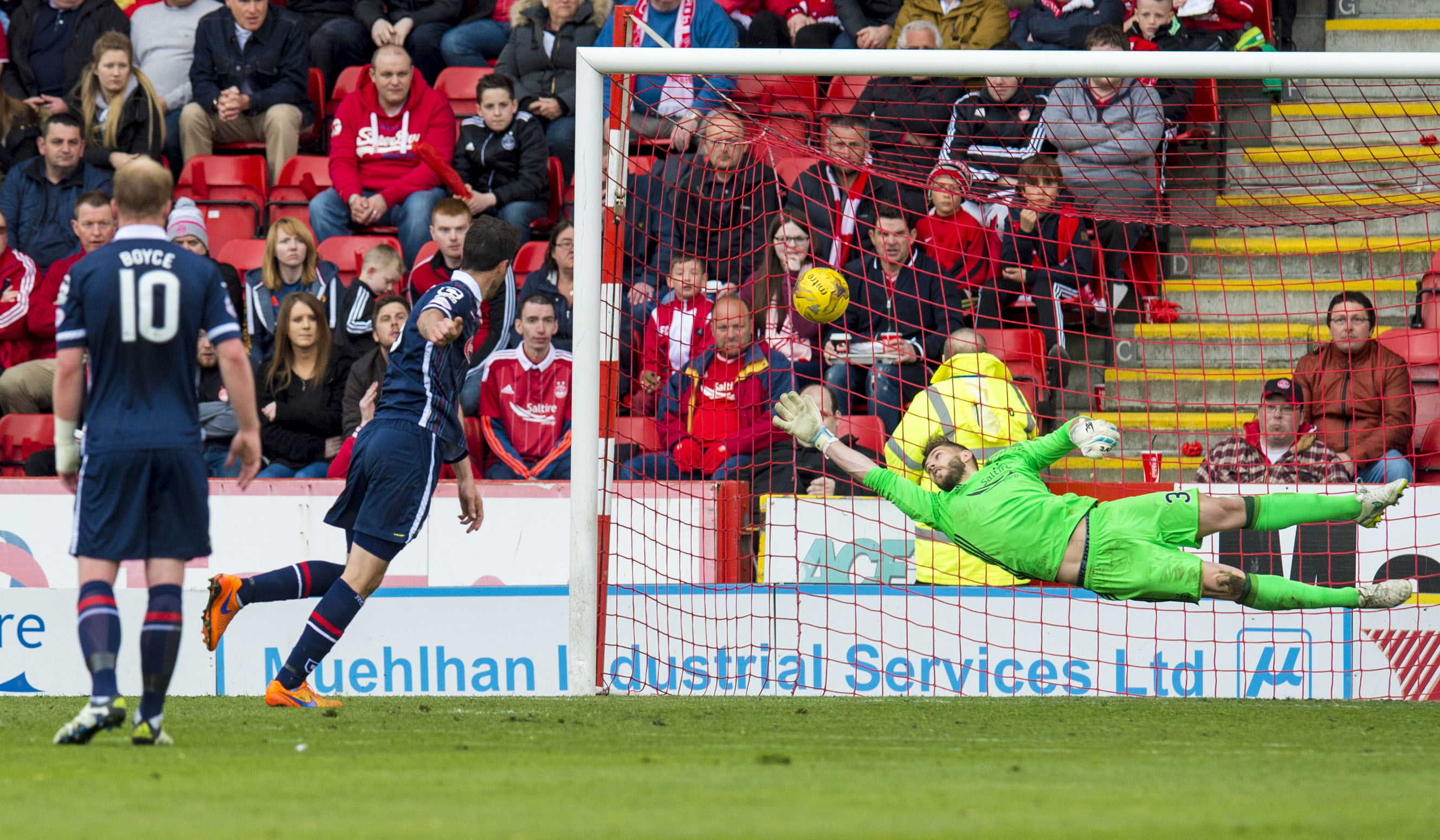 Ross County's Brain Graham (second left) opens the scoring with a penalty