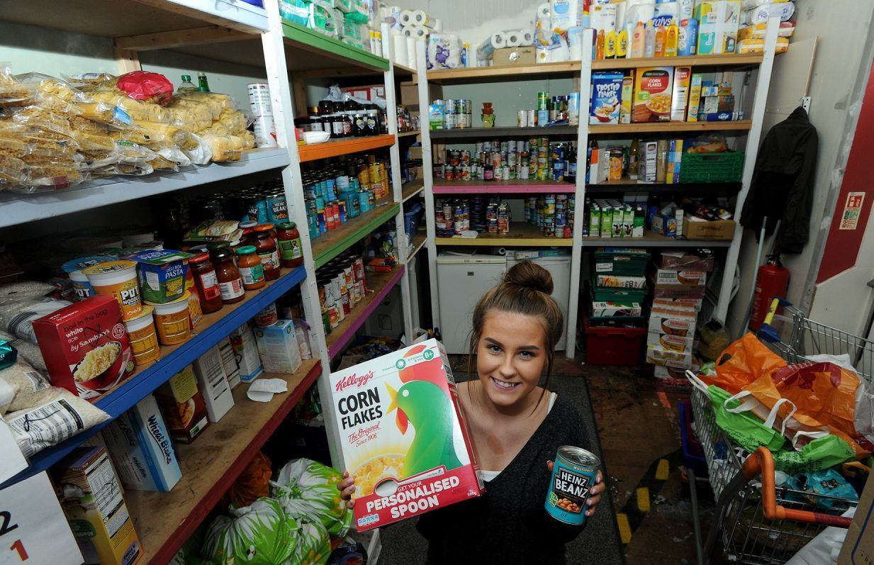 Natasha Calder with the fully-stocked Instant Neighbour food bank.