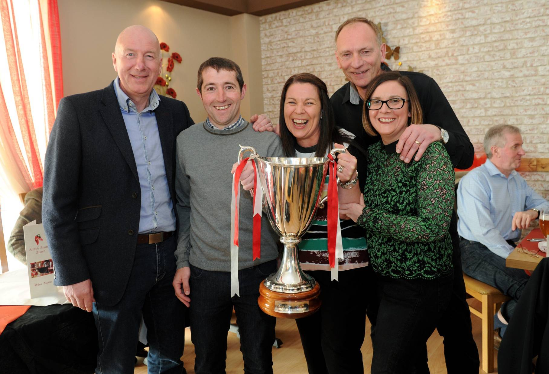 Neil Simpson and Jim Leighton with guests, from left, Bruce Harwood, Lynne Mitchell and Gail Gammie with the trophy.