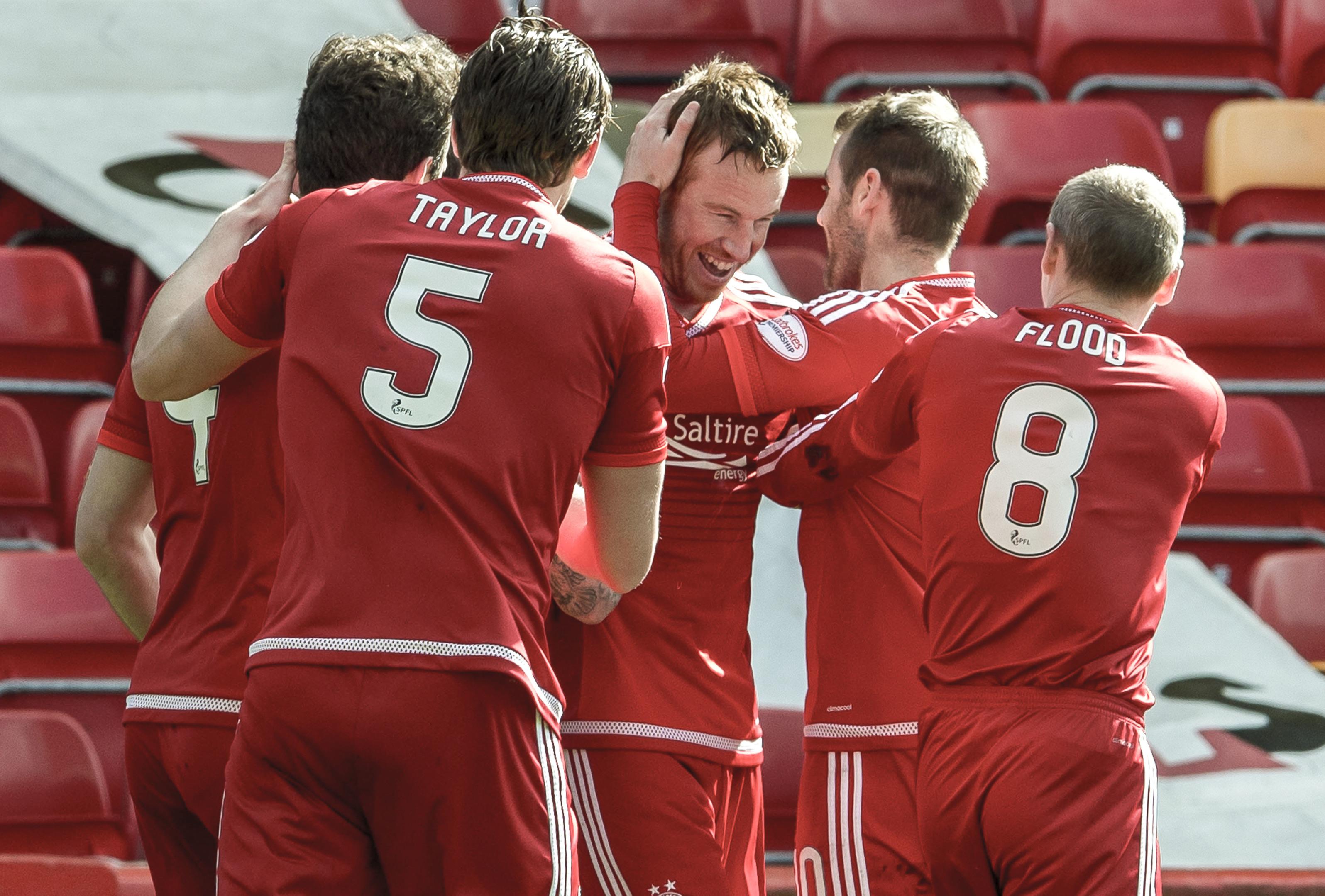 Aberdeen striker Adam Rooney wants to delay Celtic's title win.
