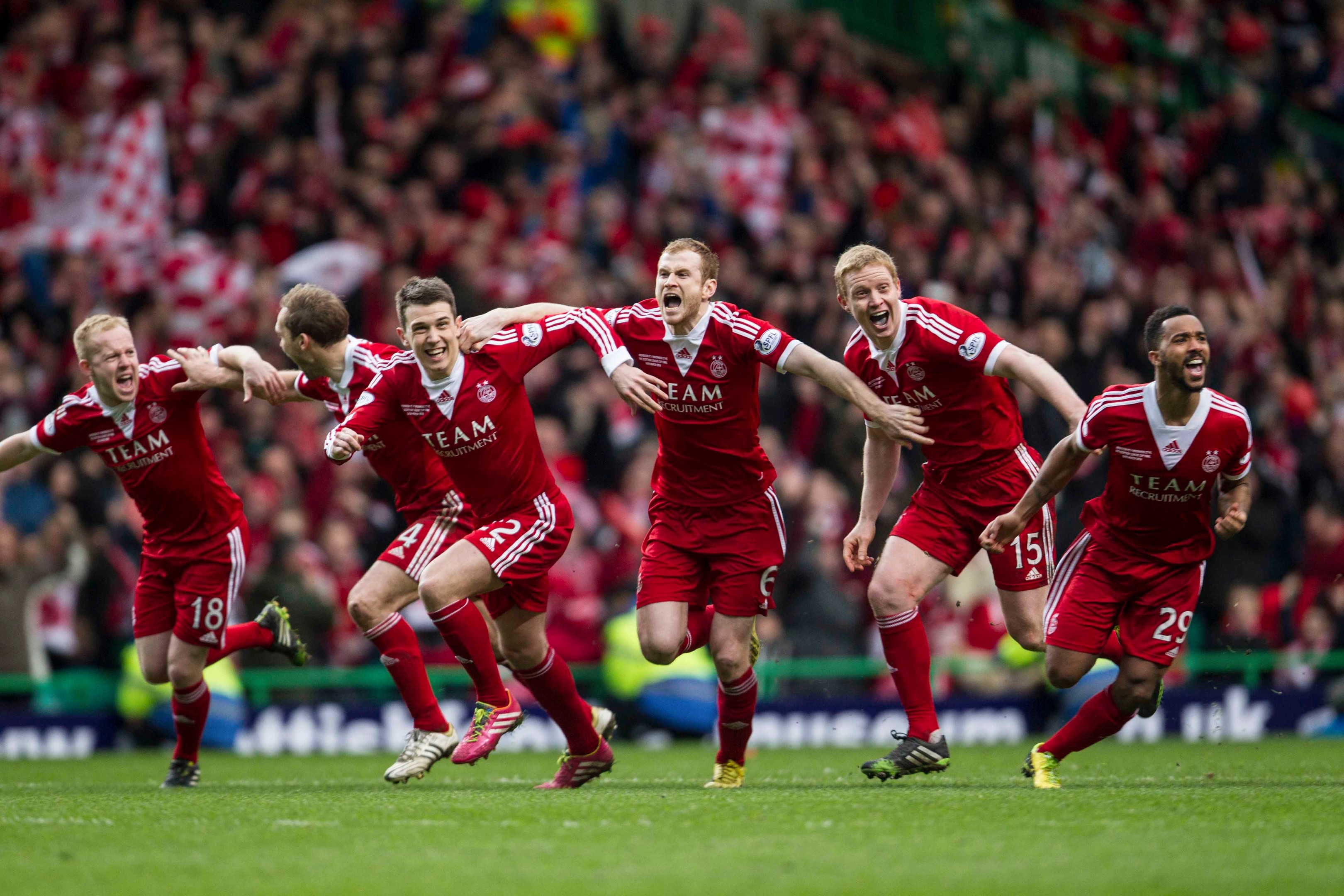 Barry Robson celebrates Aberdeen's League Cup win with his team-mates.