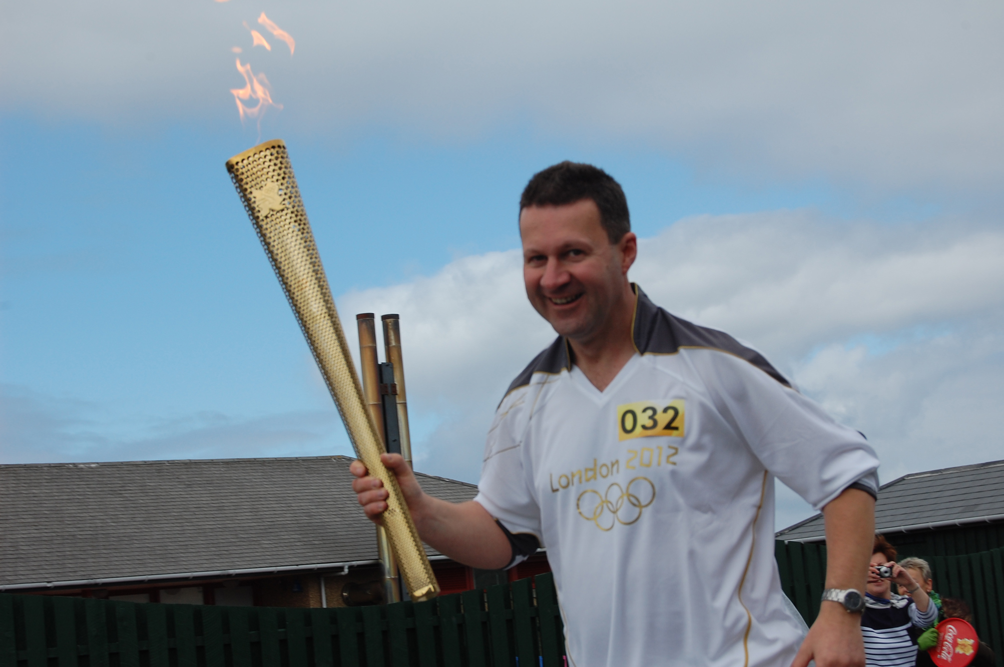 Mark Wylie carrying the torch through Lerwick in 2012.