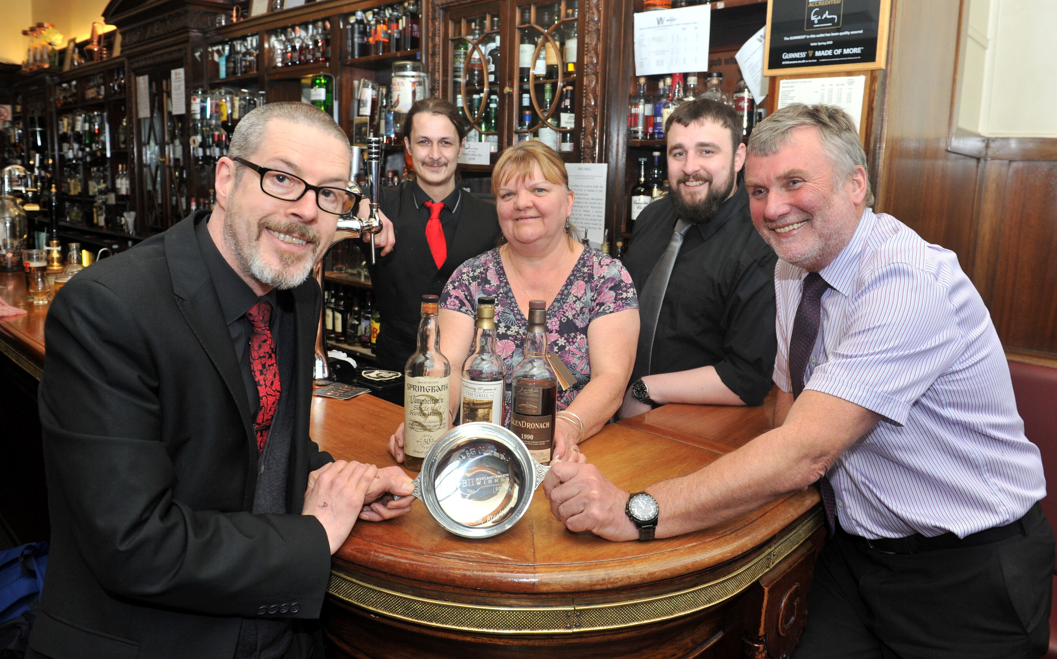 From left, Keith McKenzie, supervisor, Pete Robertson, supervisor, Rosaline Perkins, bar staff, Craig Murray, barman and Andy Juroszsek, owner, after The Grill won a national  award.