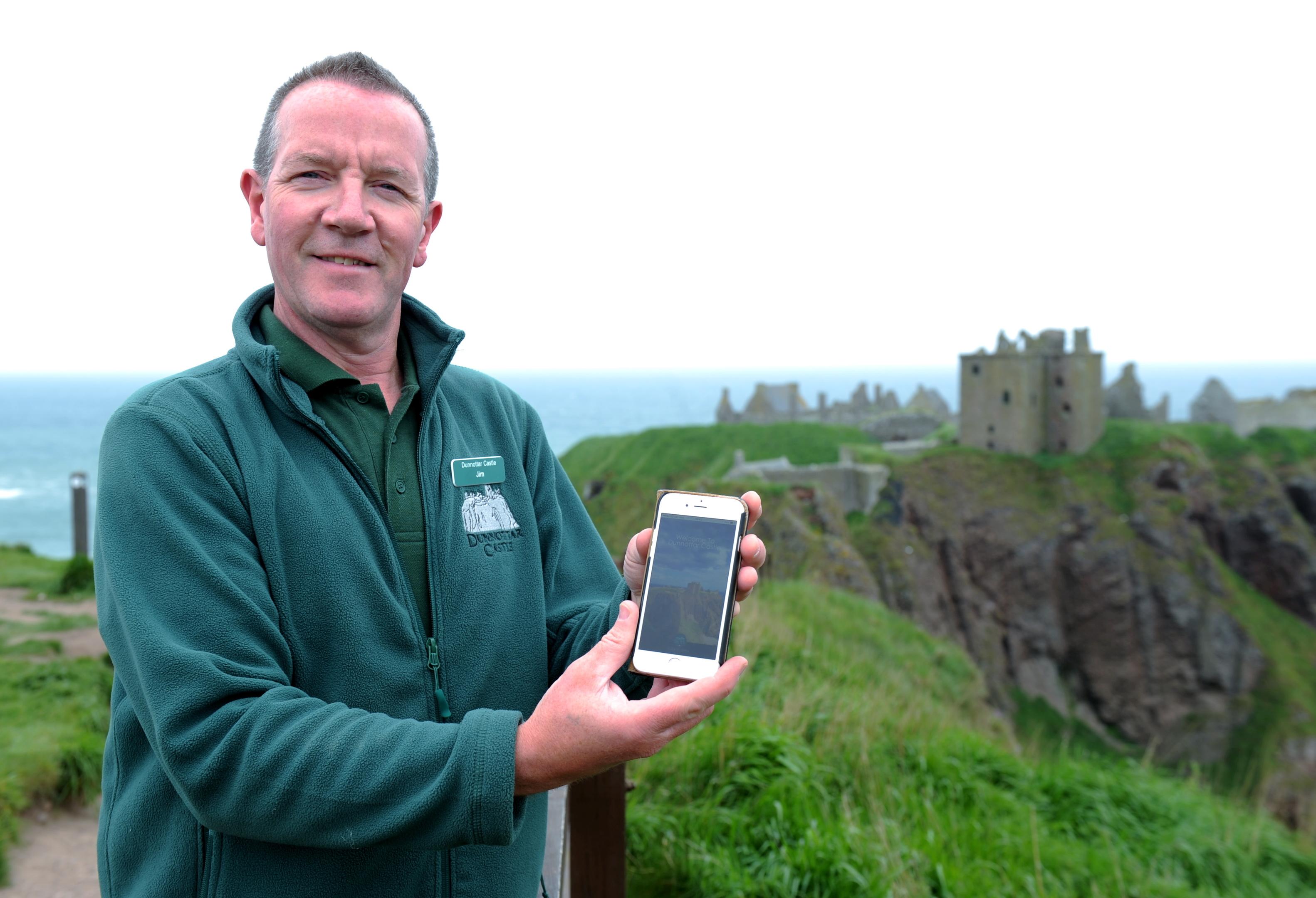 Dunnottar Castle custodian Jim Wands displays the new phone app at Dunnottar.