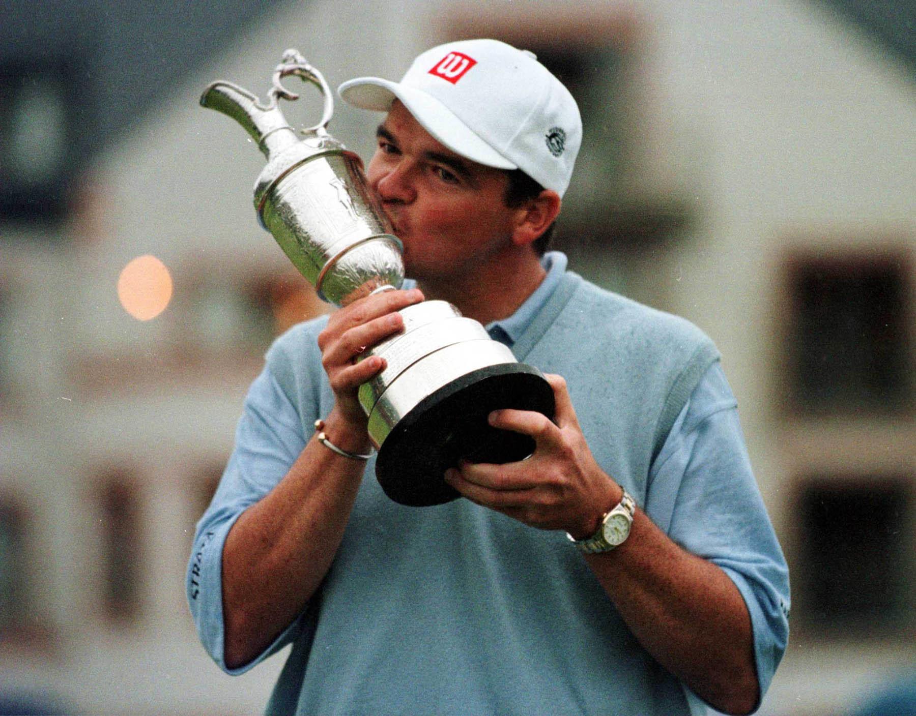Paul Lawrie kisses the famous Claret Jug after securing the 1999 Open  title at Carnoustie.