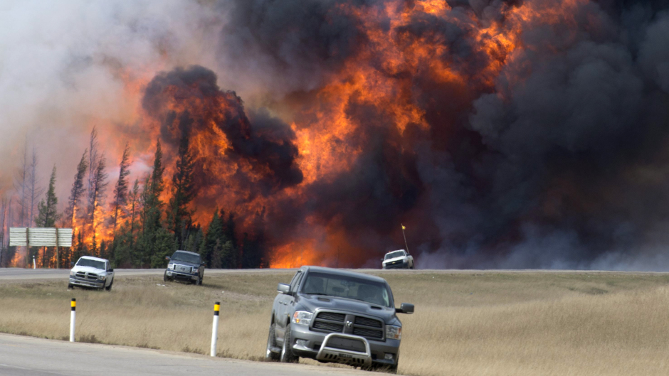 A wildfire burns close to Highway 63 just south of Fort McMurray in Alberta Canada.