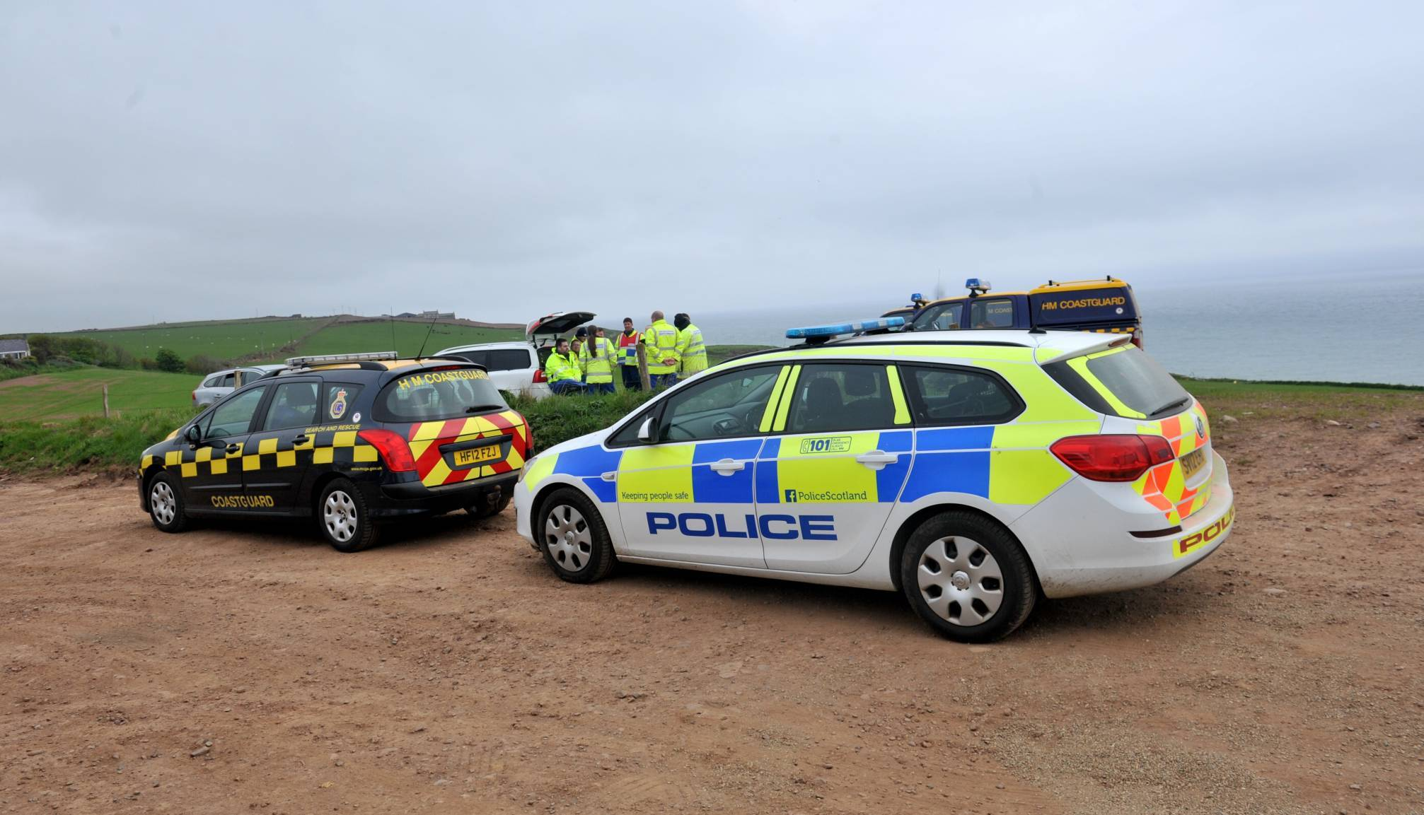 Police on the scene at cliffs near Kinneff today