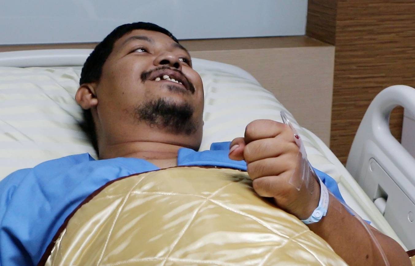 Attaporn Boonmakchuay tells reporters about his ordeal from his hospital bed