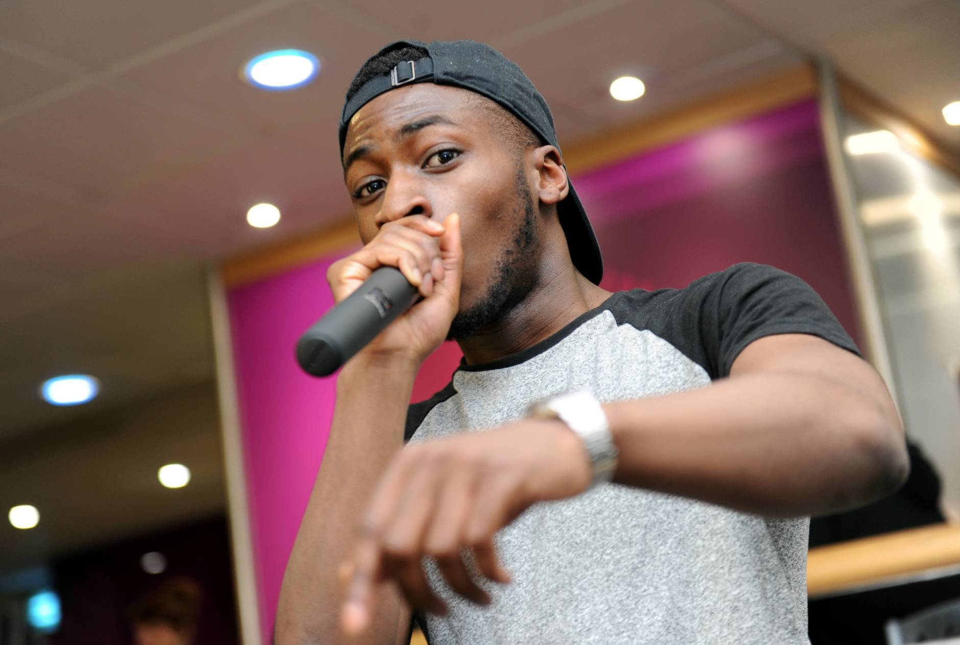 Pictured is rapper Ransom FA (aka Efe Ibojie) performing at North East Scotland College.