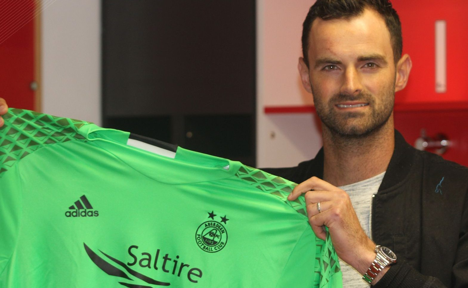 Joe Lewis has signed for Aberdeen.