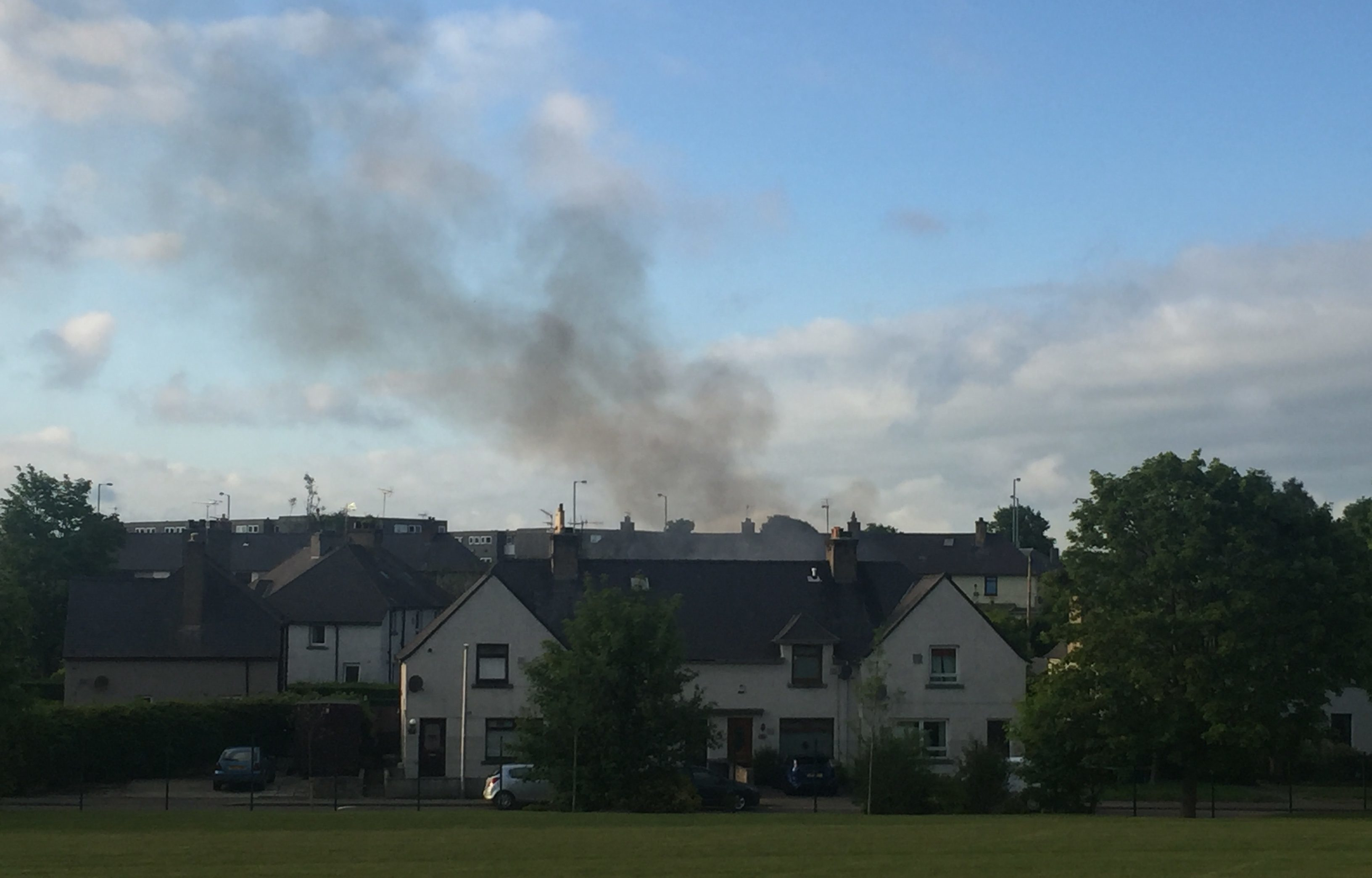 Smoke can be seen rising from the fire