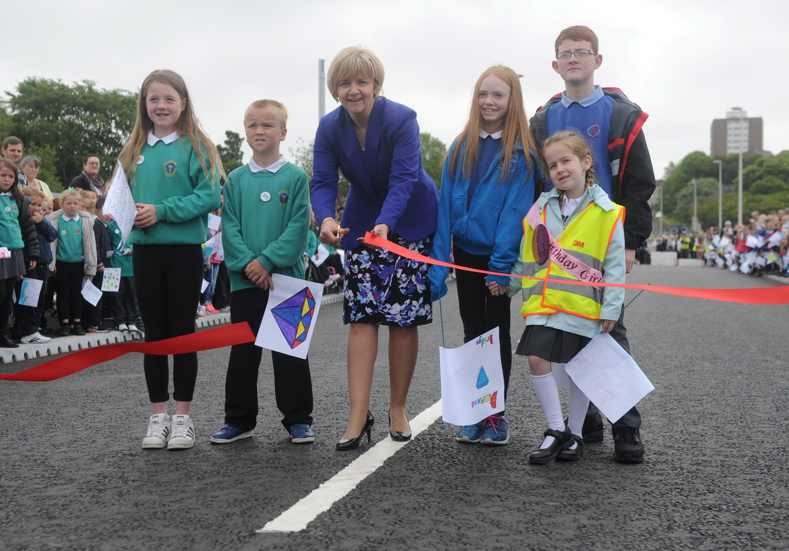 Jenny Laing performs the ceremonial cutting with children from Danestone and Riverbank primaries.