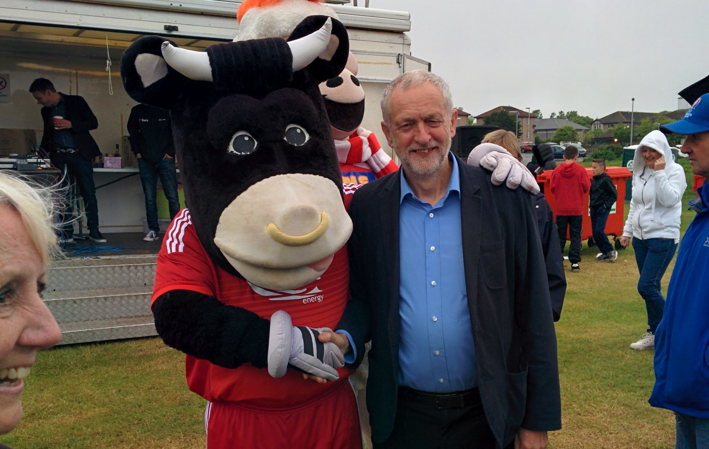 Labour leader Jeremy Corbyn poses with Dons mascot Angus the Bull
