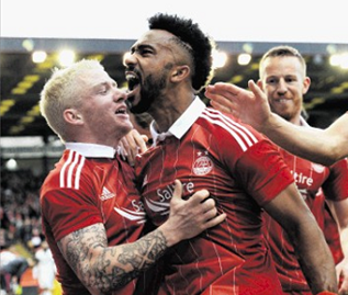 Shay Logan celebrates after Aberdeen's opener